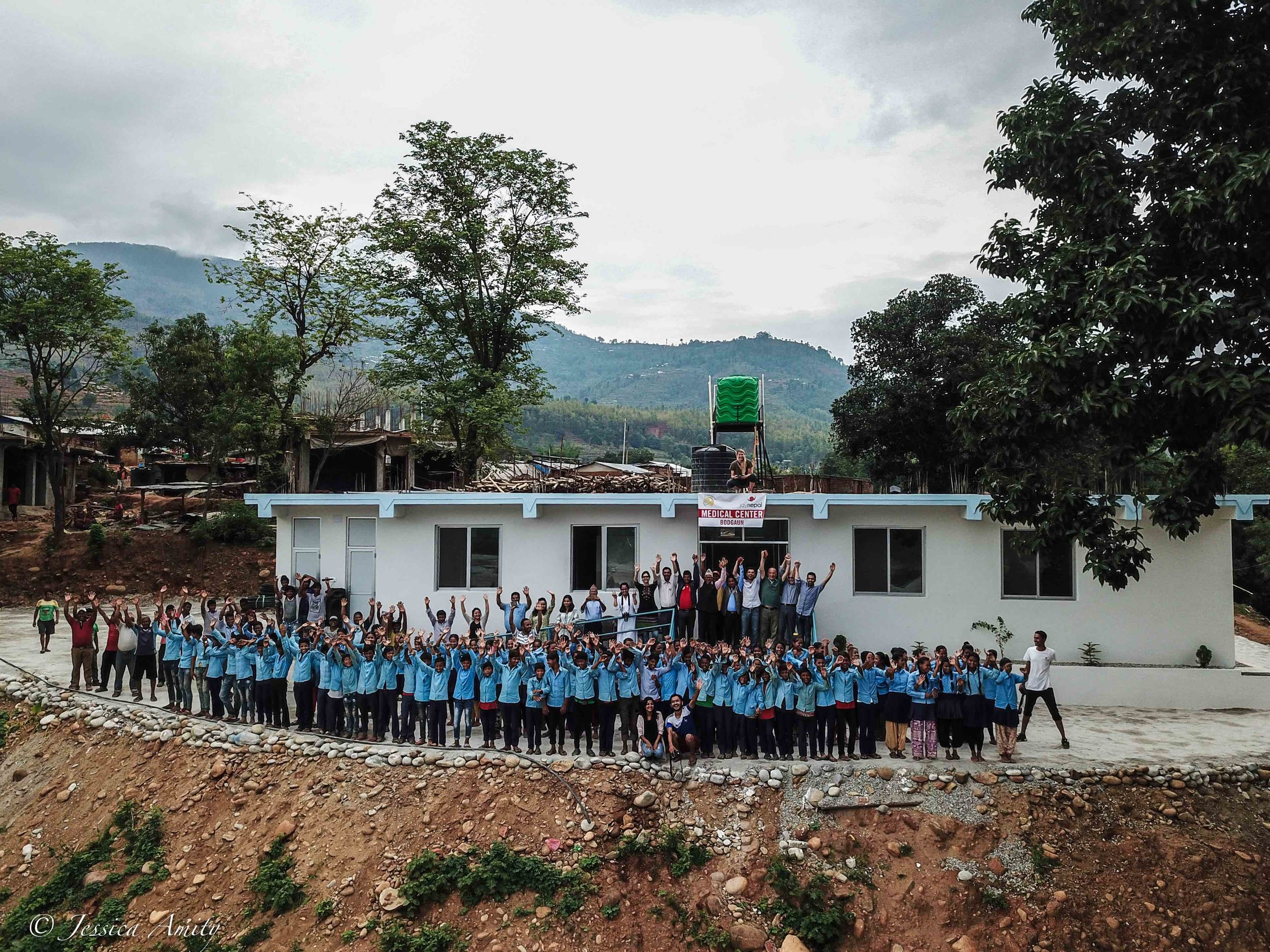 A drone image of the newly completed Medical Centre. Volunteers and sponsors are joined by children from the near by school.