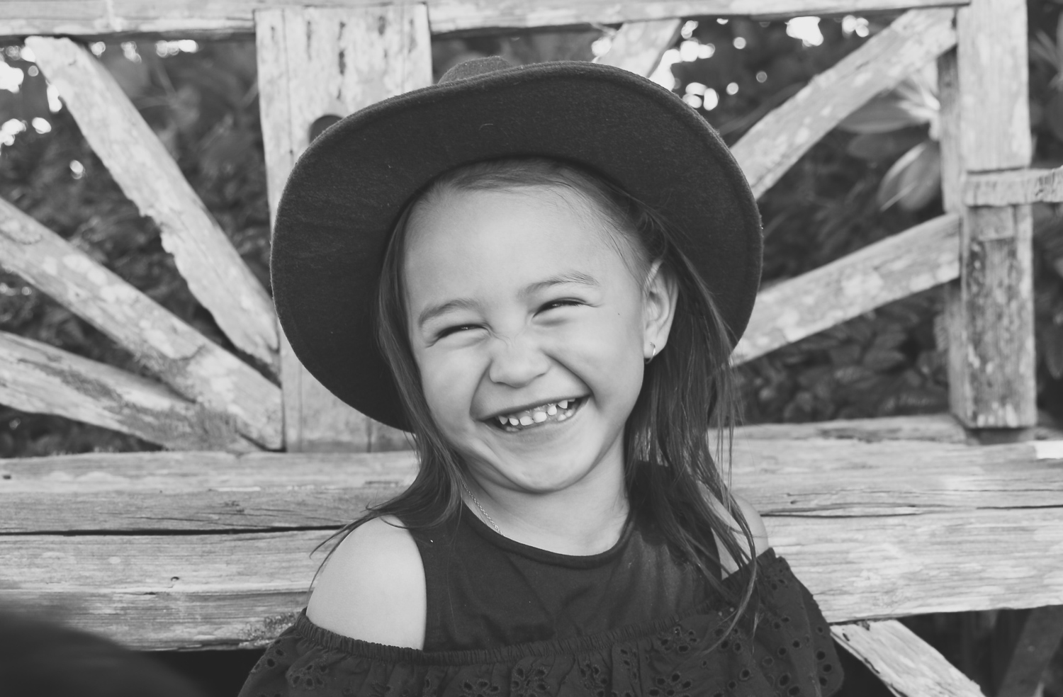 black-and-white-image-of-girl-laughing-wearing-cool-hat-laughing_L-R.jpg