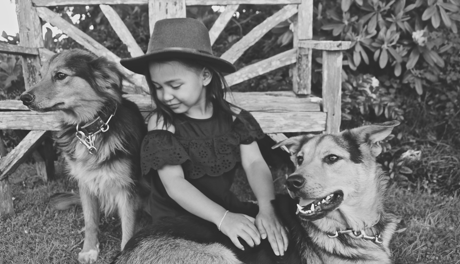 black-and-white-image-of-girl-with-her-farm-dogs-wearing-farm-hat_L-R.jpg