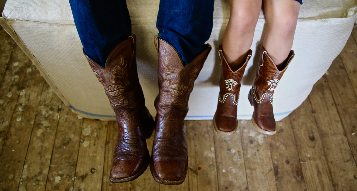 cowgirl-little-girl-and-cowboy-dad-boots-together_L-R.jpg