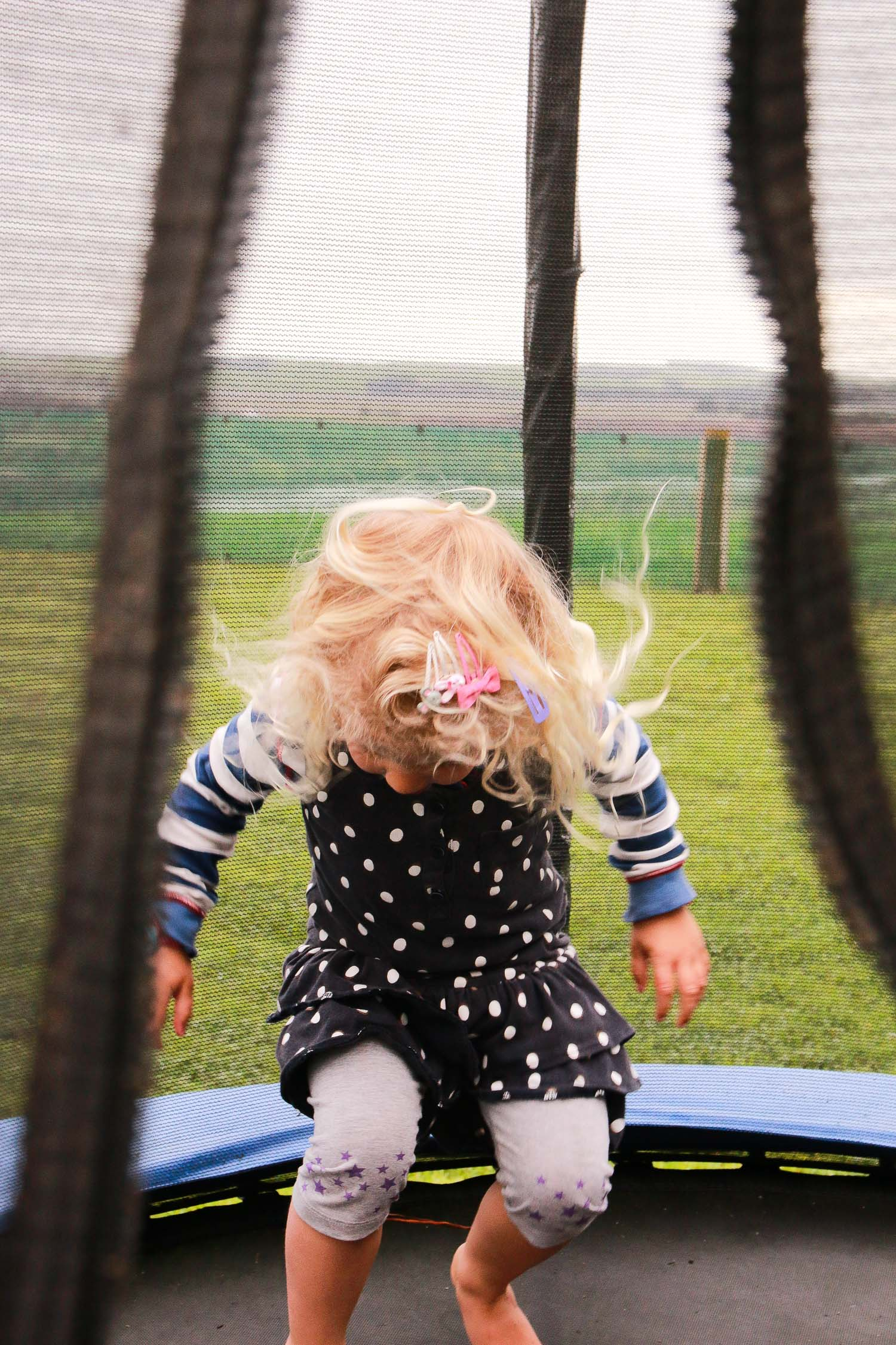 girl-jumping-on-trampoline.jpg