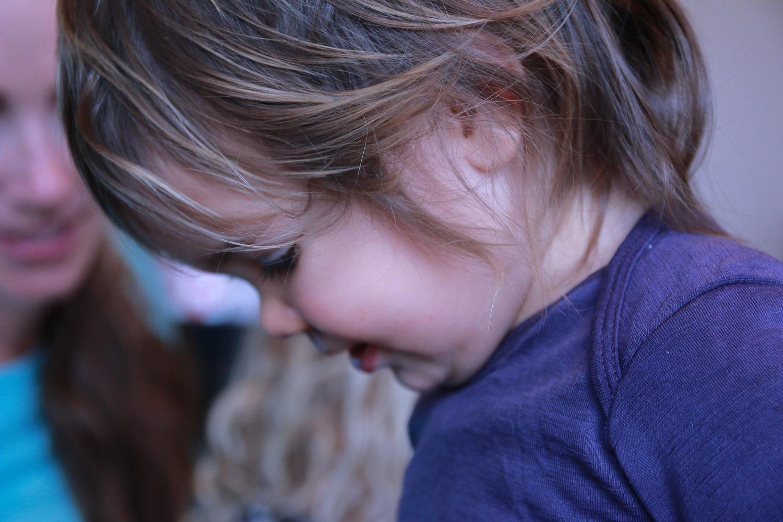 little-girl-wearing-purple-with-brown-hair-smiling.jpg