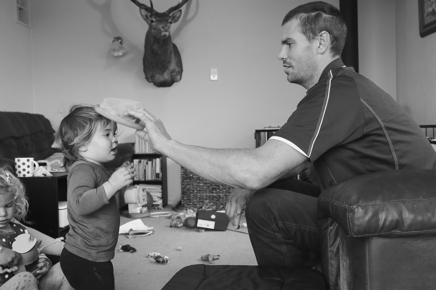 rowland-smith-shearer-playing-with-daughter-at-home-in-lounge.jpg