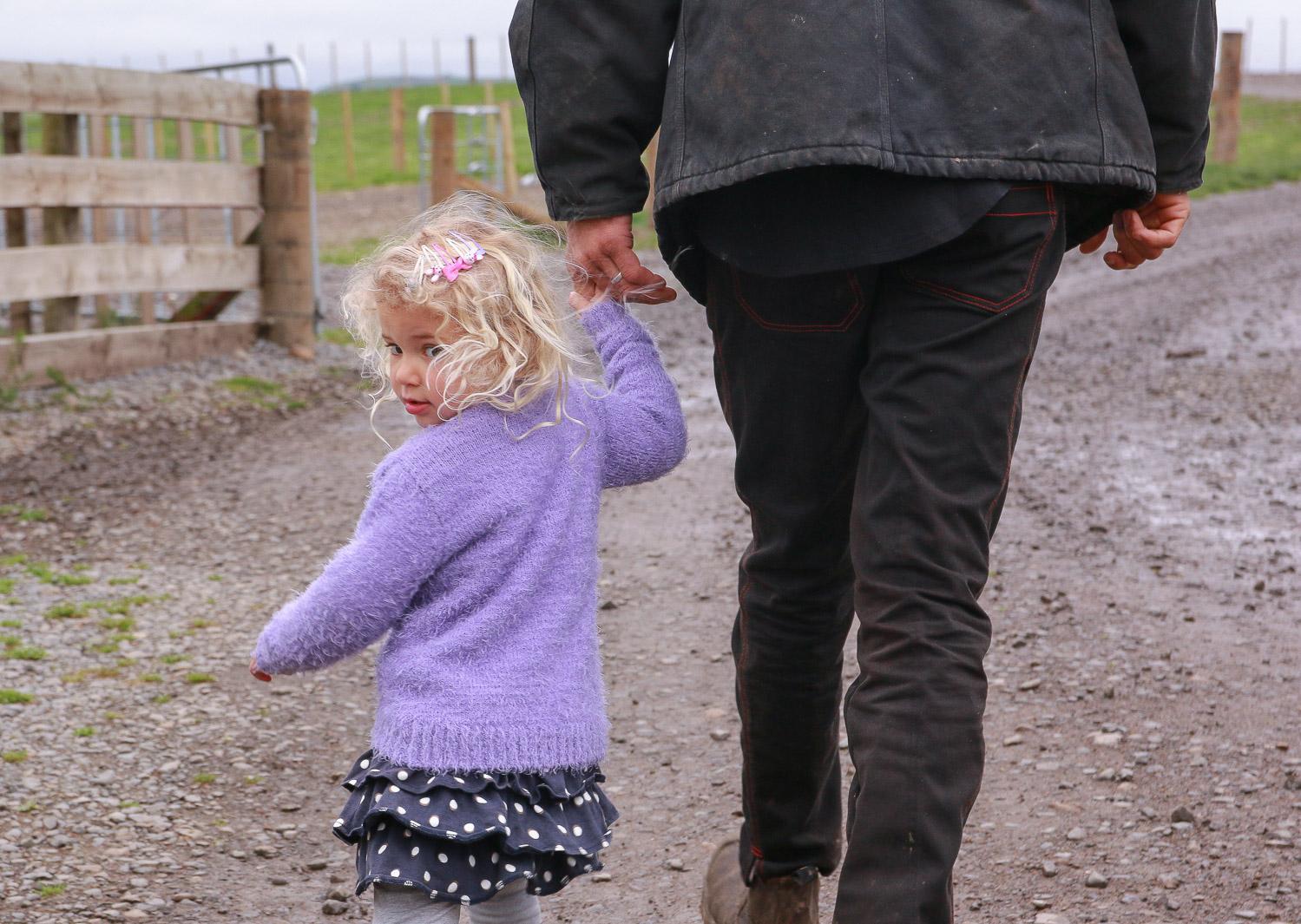 little-girl-with-dad-walking-away-looking-back.jpg