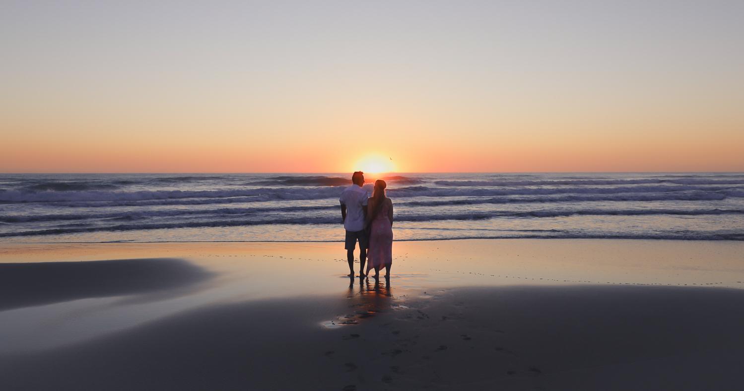 woman and man watching sun rise