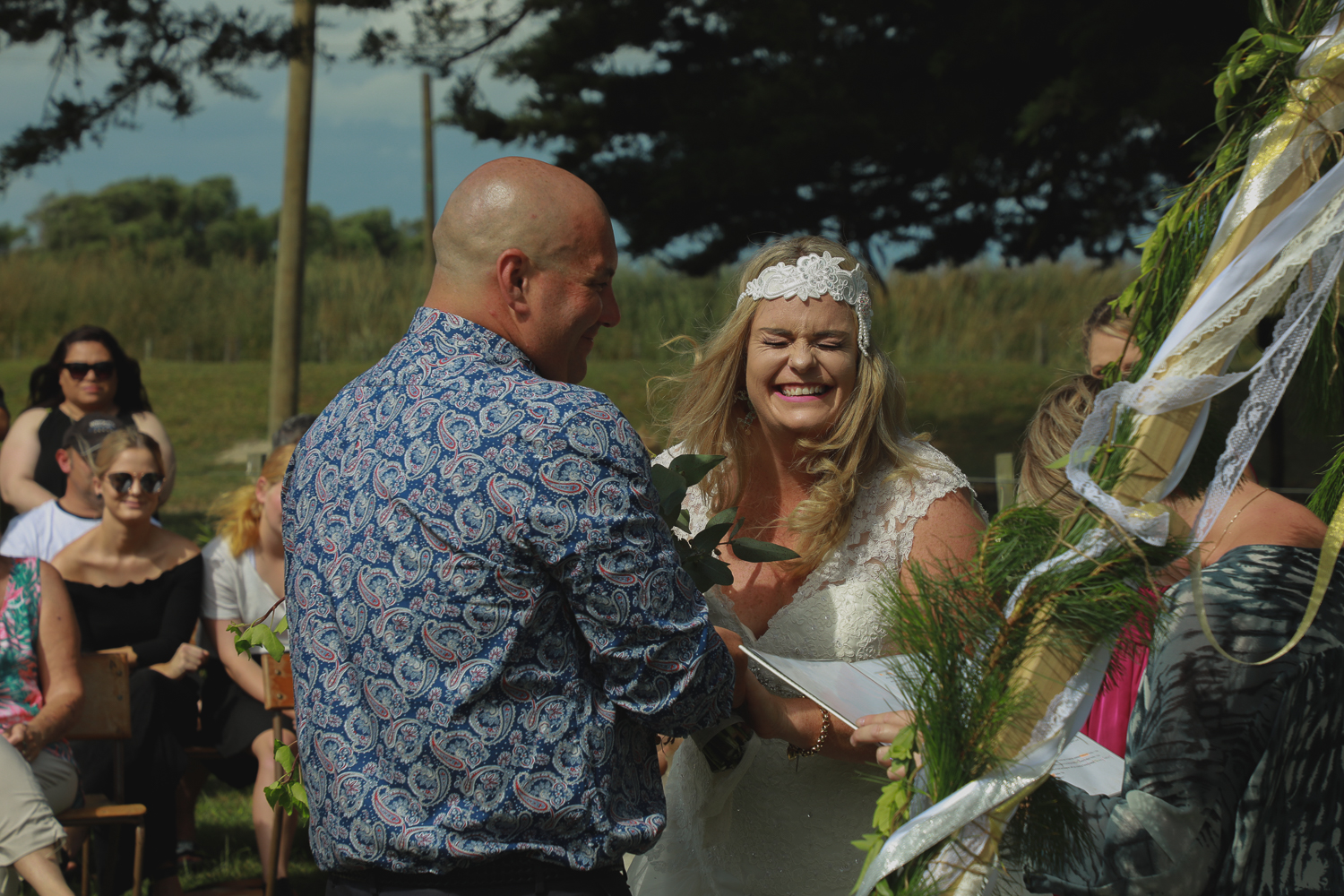 bride laughing during ceremony