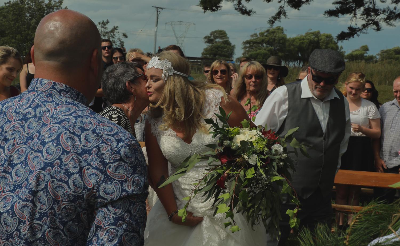 bride kissing mum