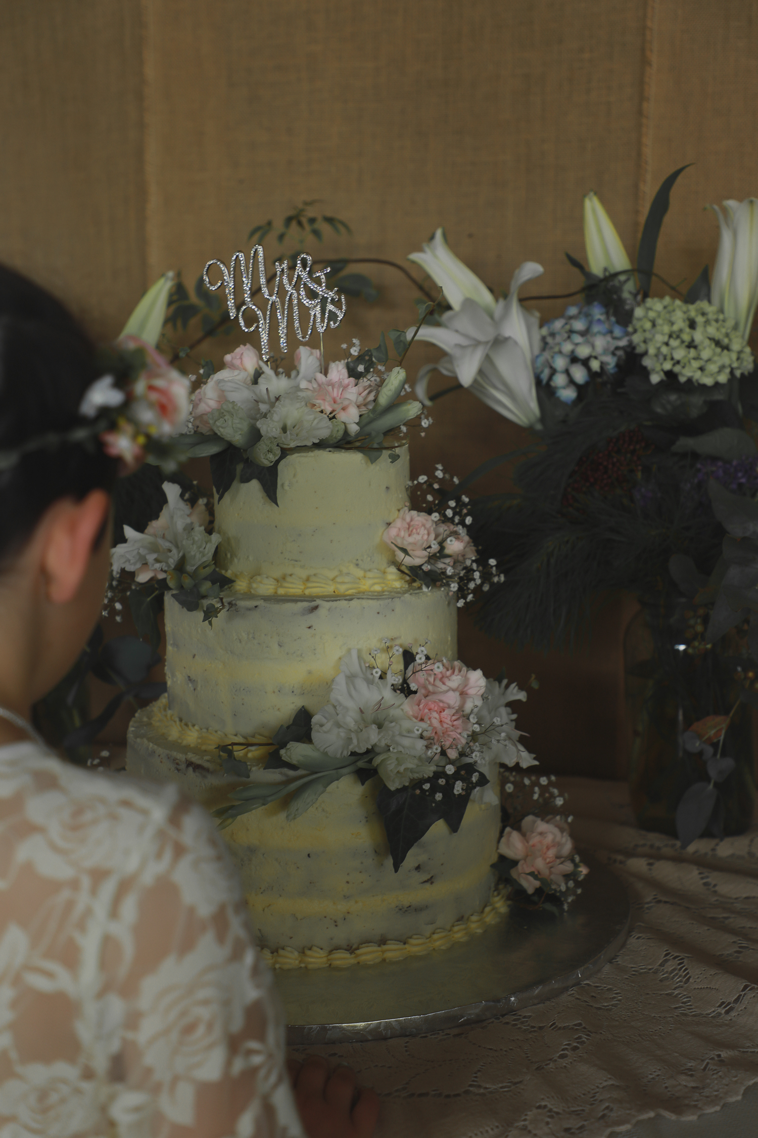 wedding-photography-flower-girl-looking-on-at-cake.jpg