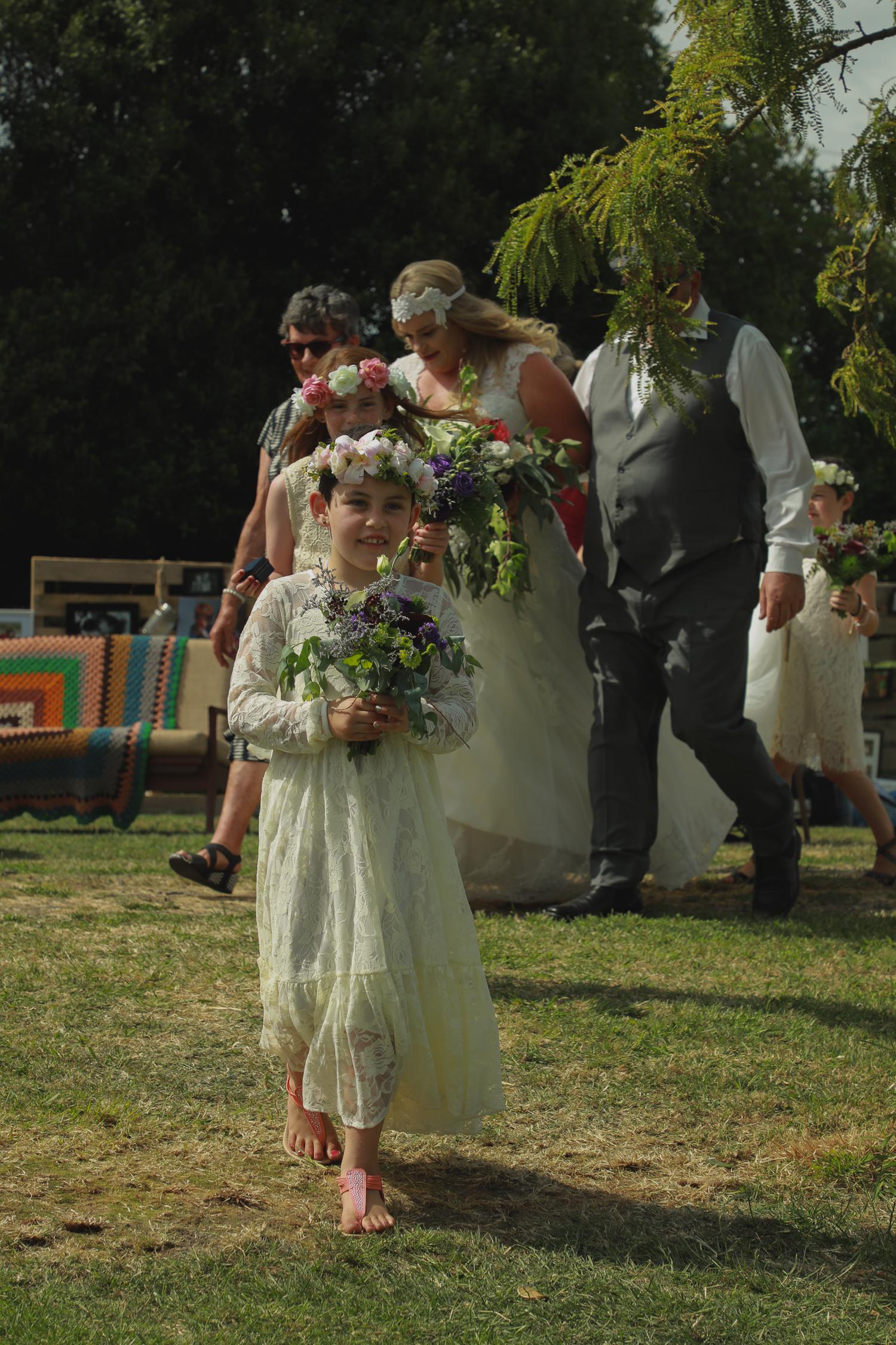 wedding-photography-flower-girl-walking-in.jpg