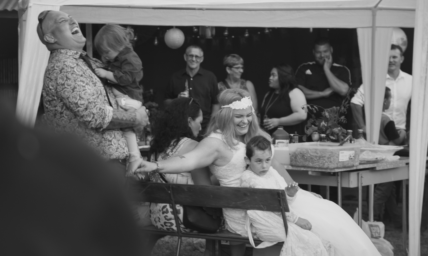 wedding-photography-black-and-white--bride-and-groom-lauhging-during-speeches.jpg