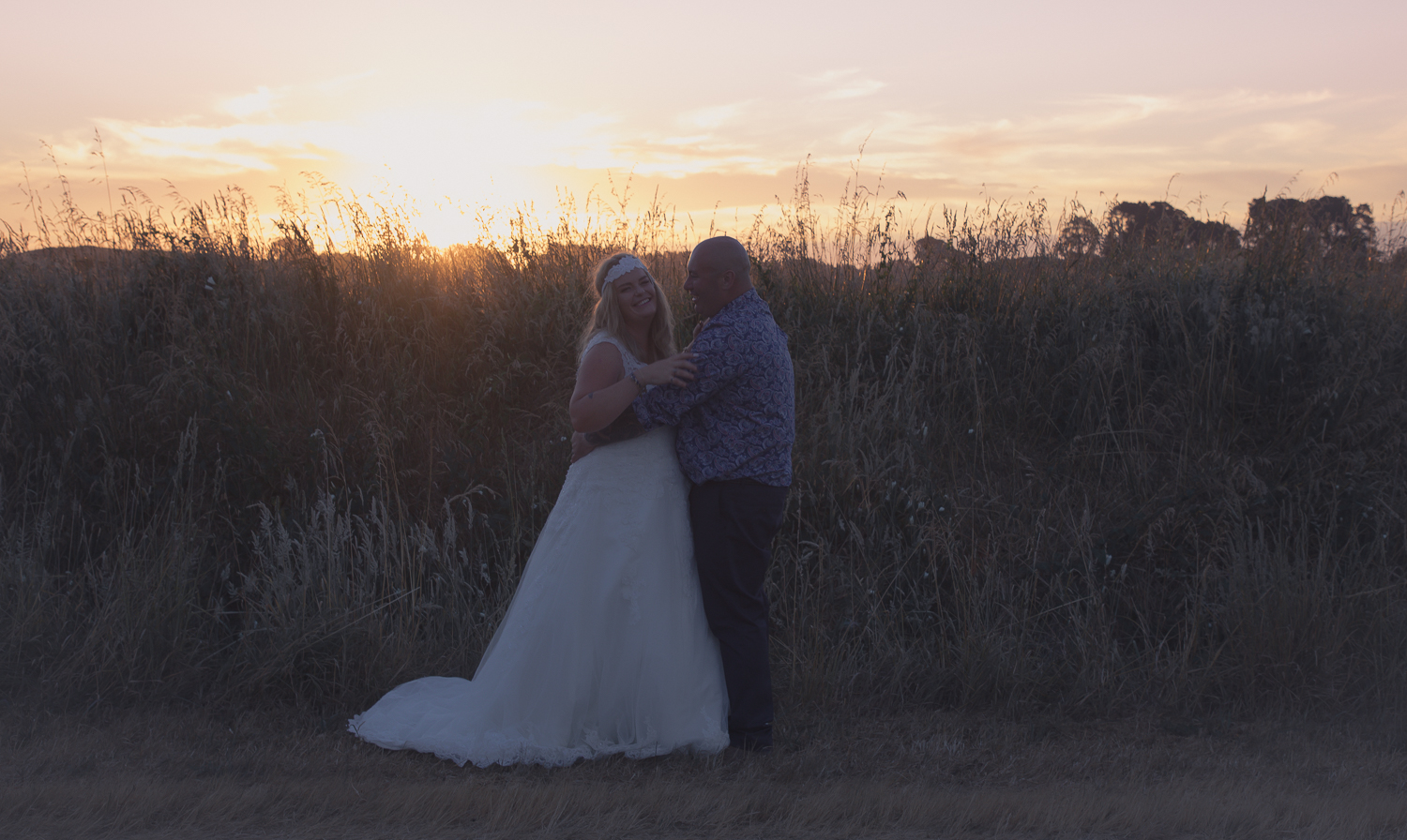 wedding-photography-bride-and-groom-laughing-together-at-sunset.jpg