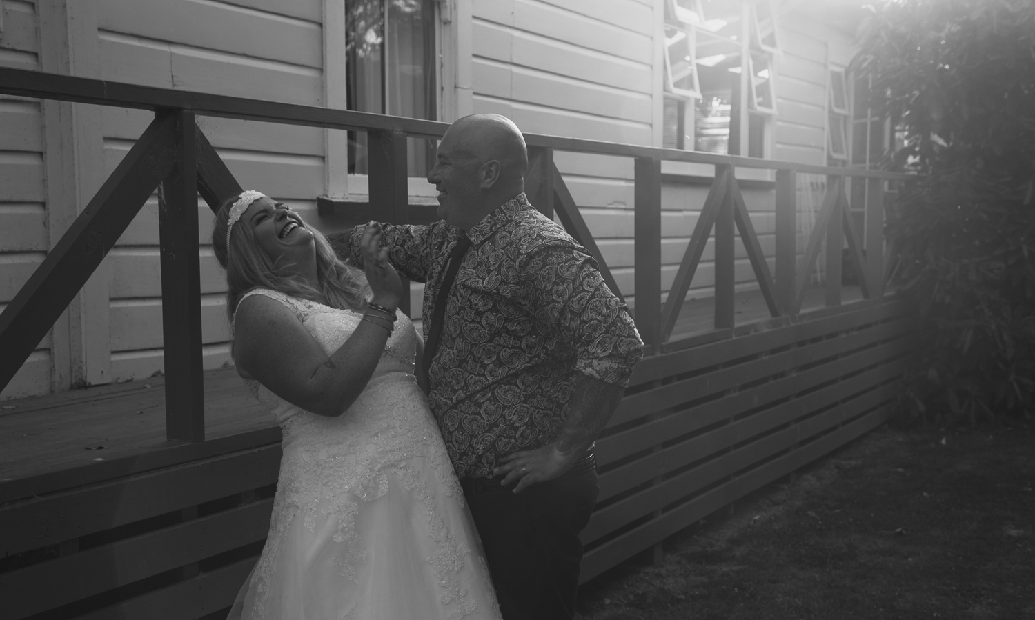 wedding-photography-bride-and-groom-laughing-together-black-and-white.jpg