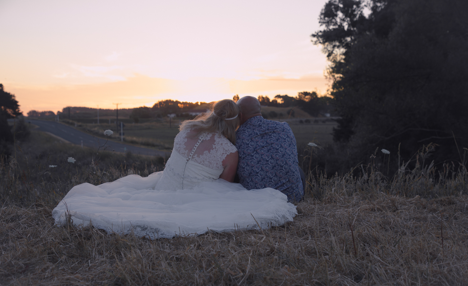 wedding-photography-bride-and-groom-watching-sunset-together.jpg