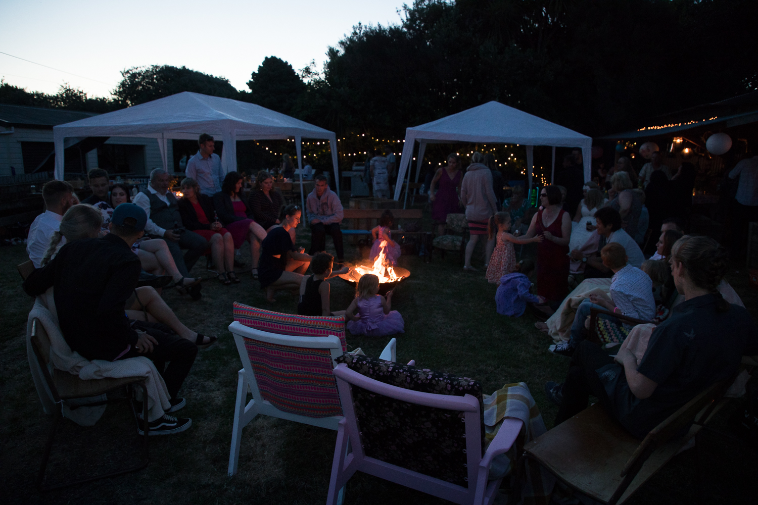 wedding-photography-guests-sitting-around-the-fire-pit.jpg