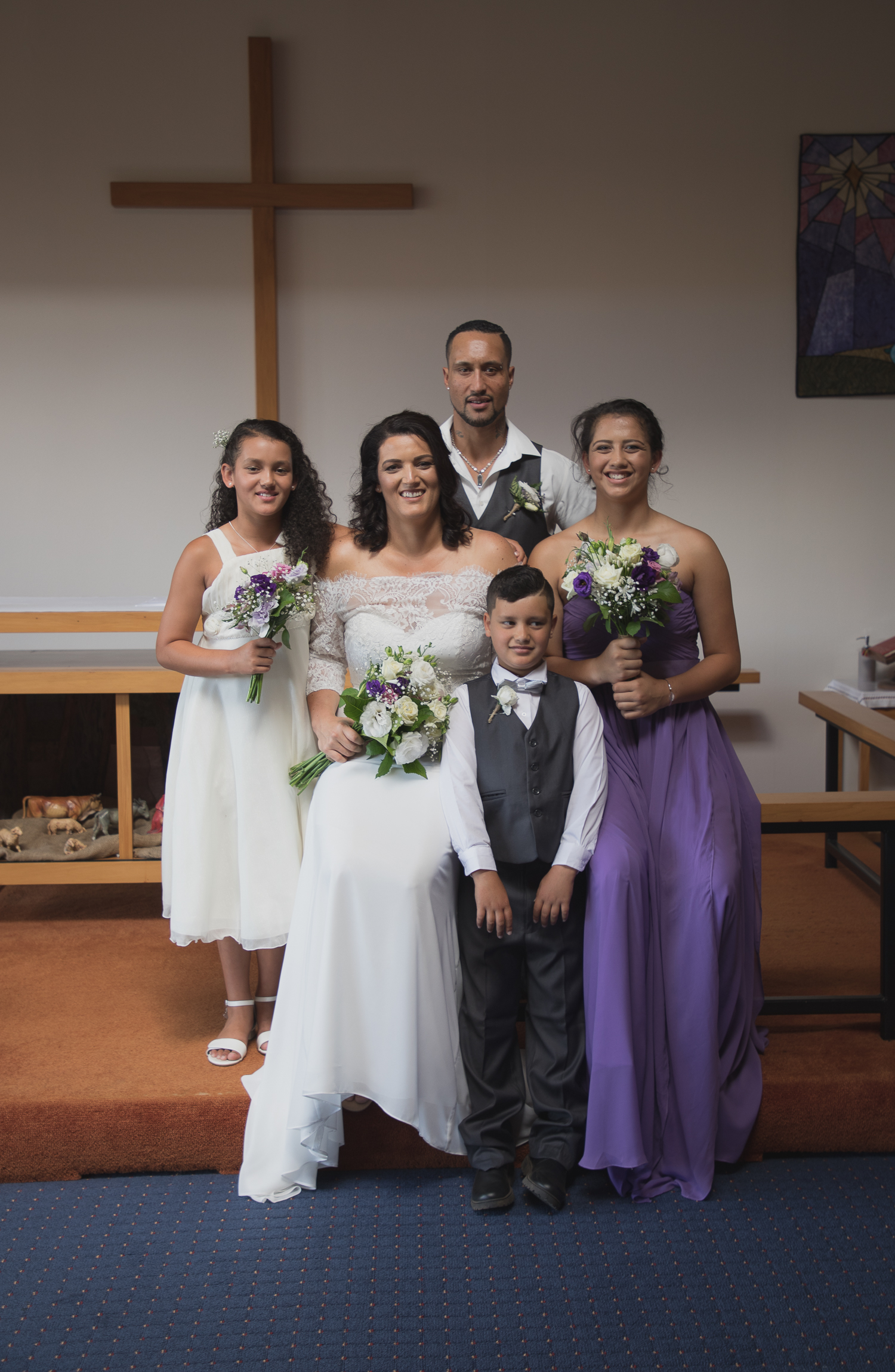 bride and groom with kids in church