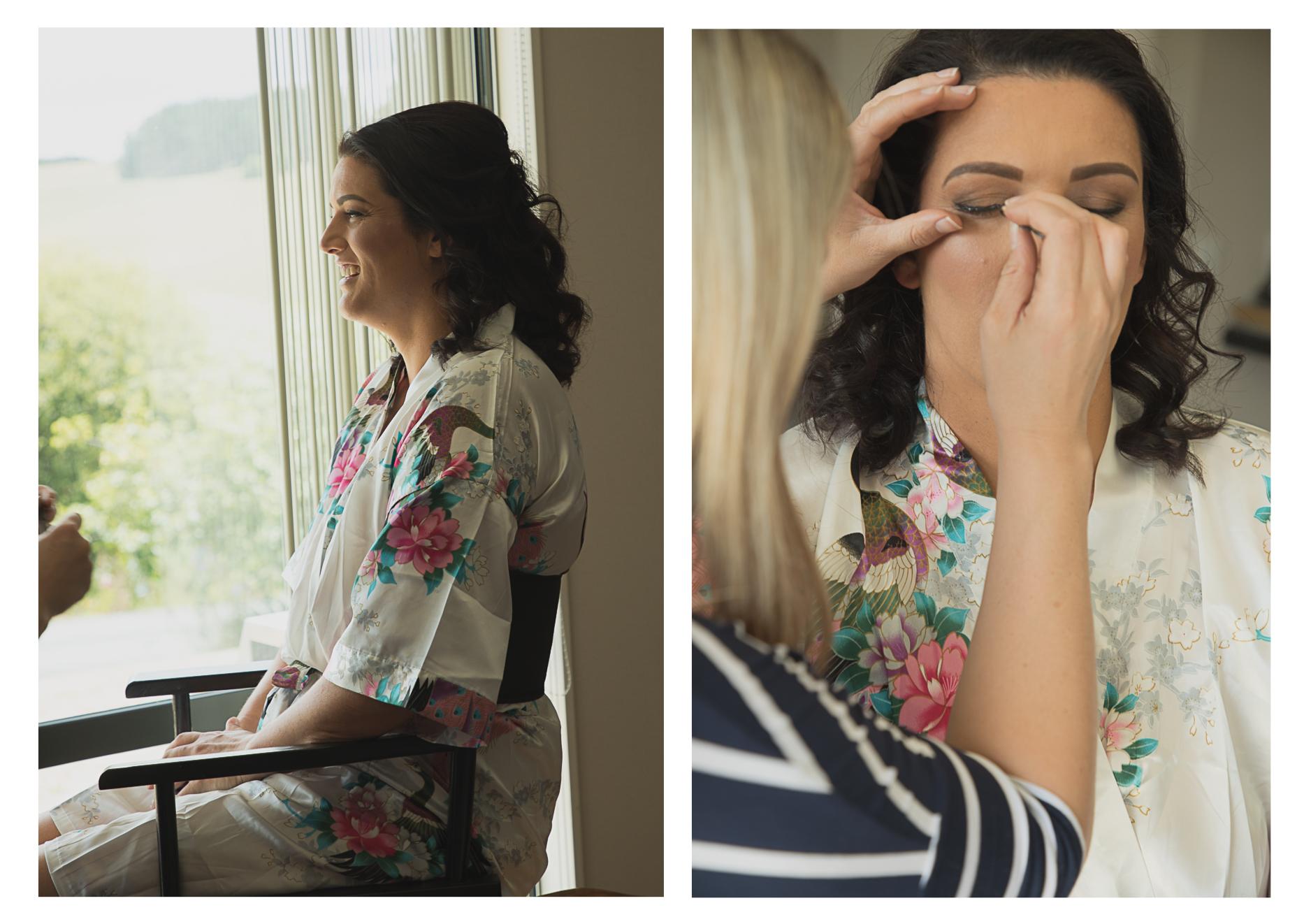 bride having wedding makeup done