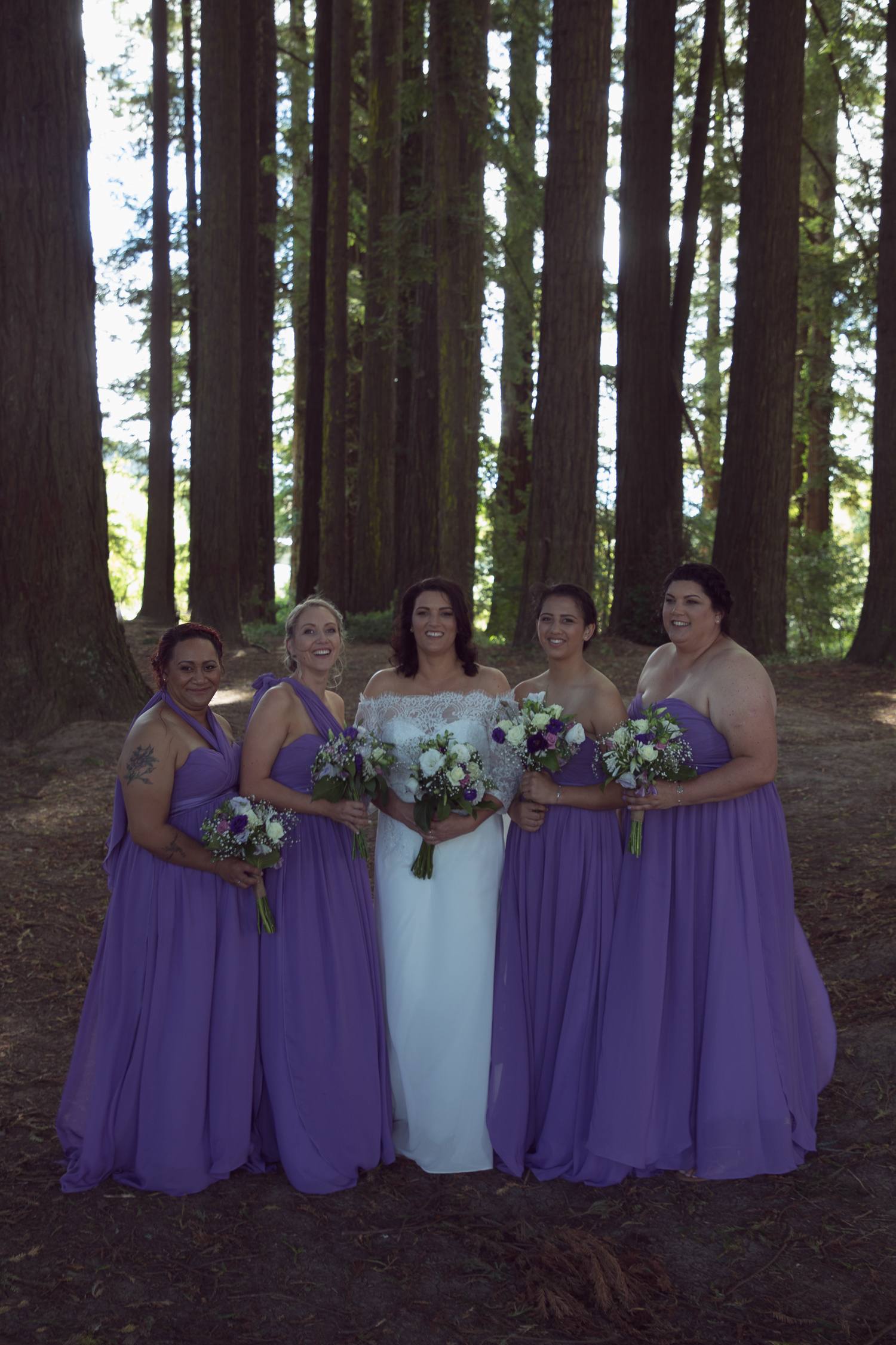 bride and bridesmaids in redwoods forest