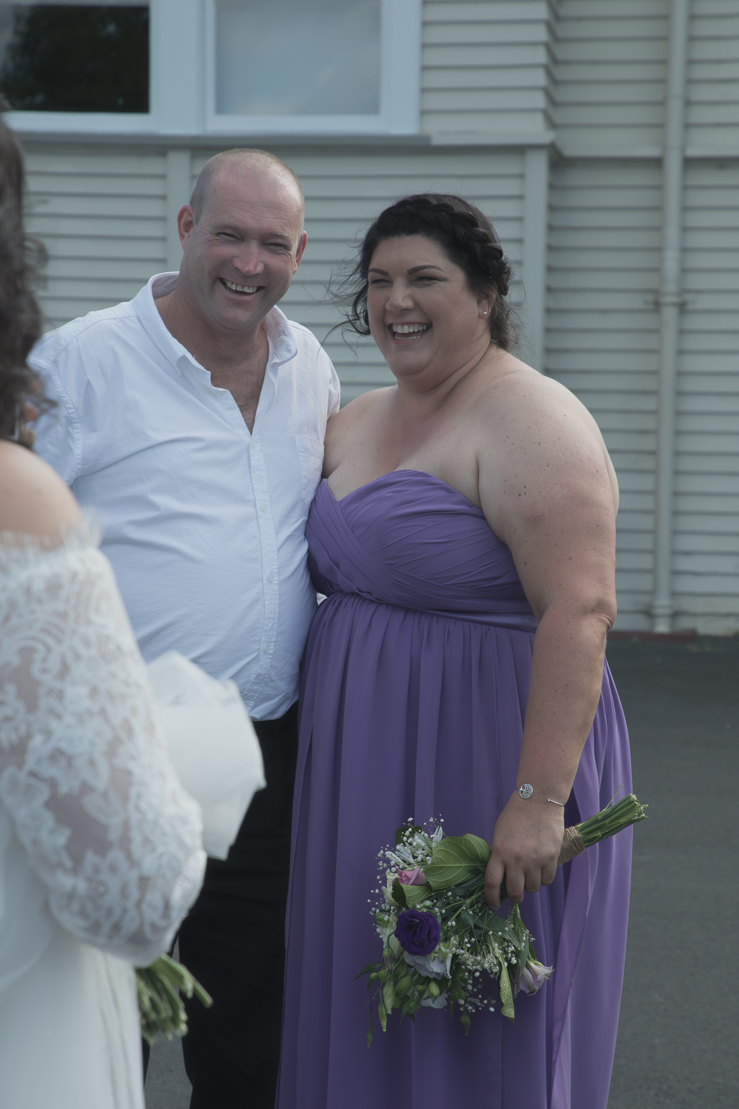 bridesmaid and husband having photo together