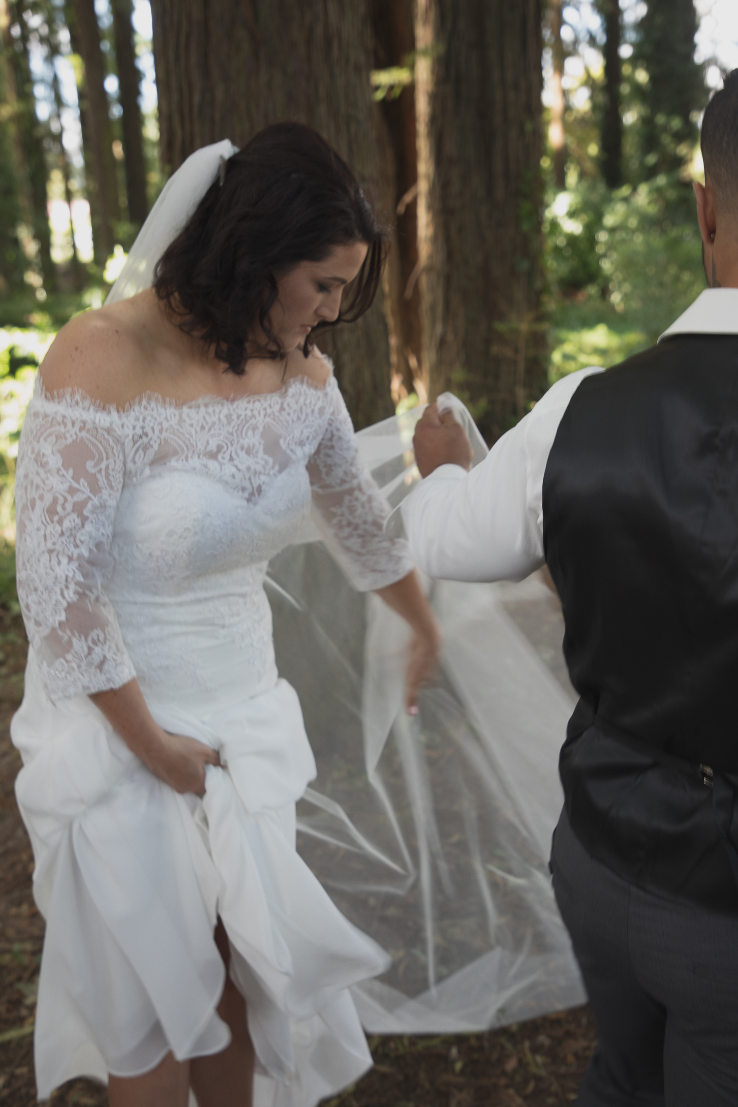 bride and groom in redwoods forest during wedding photos