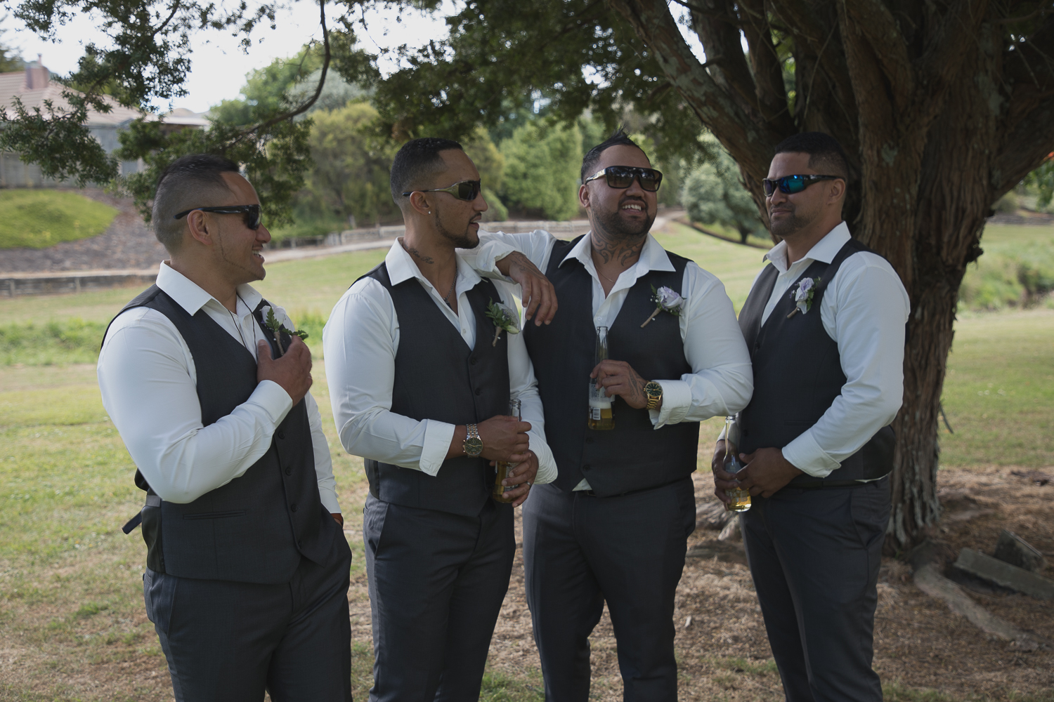 groom with groomsmen laughing together