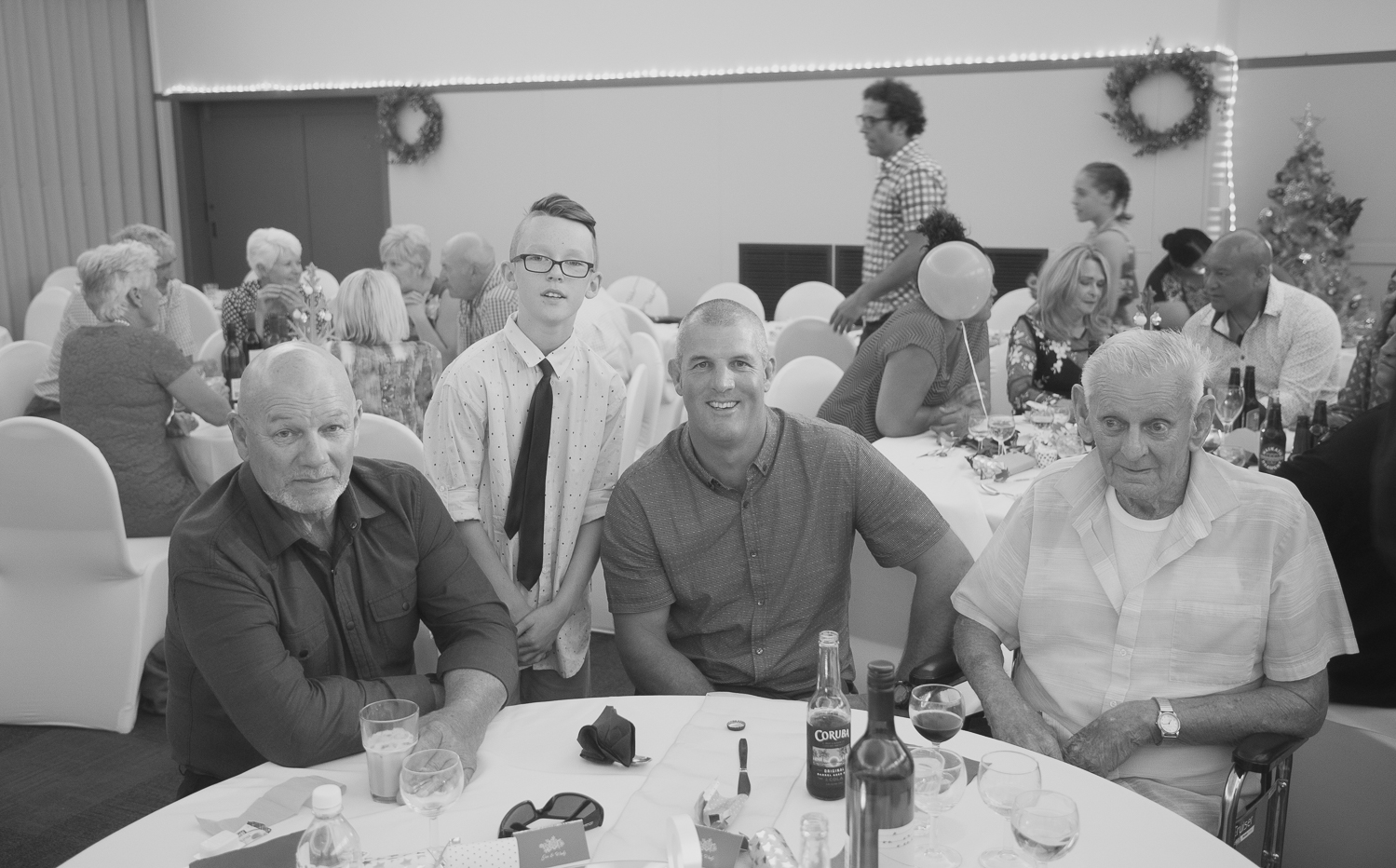 family four generations during wedding reception