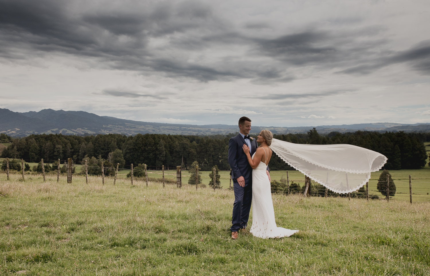 bride and groom with mt pirongia in background