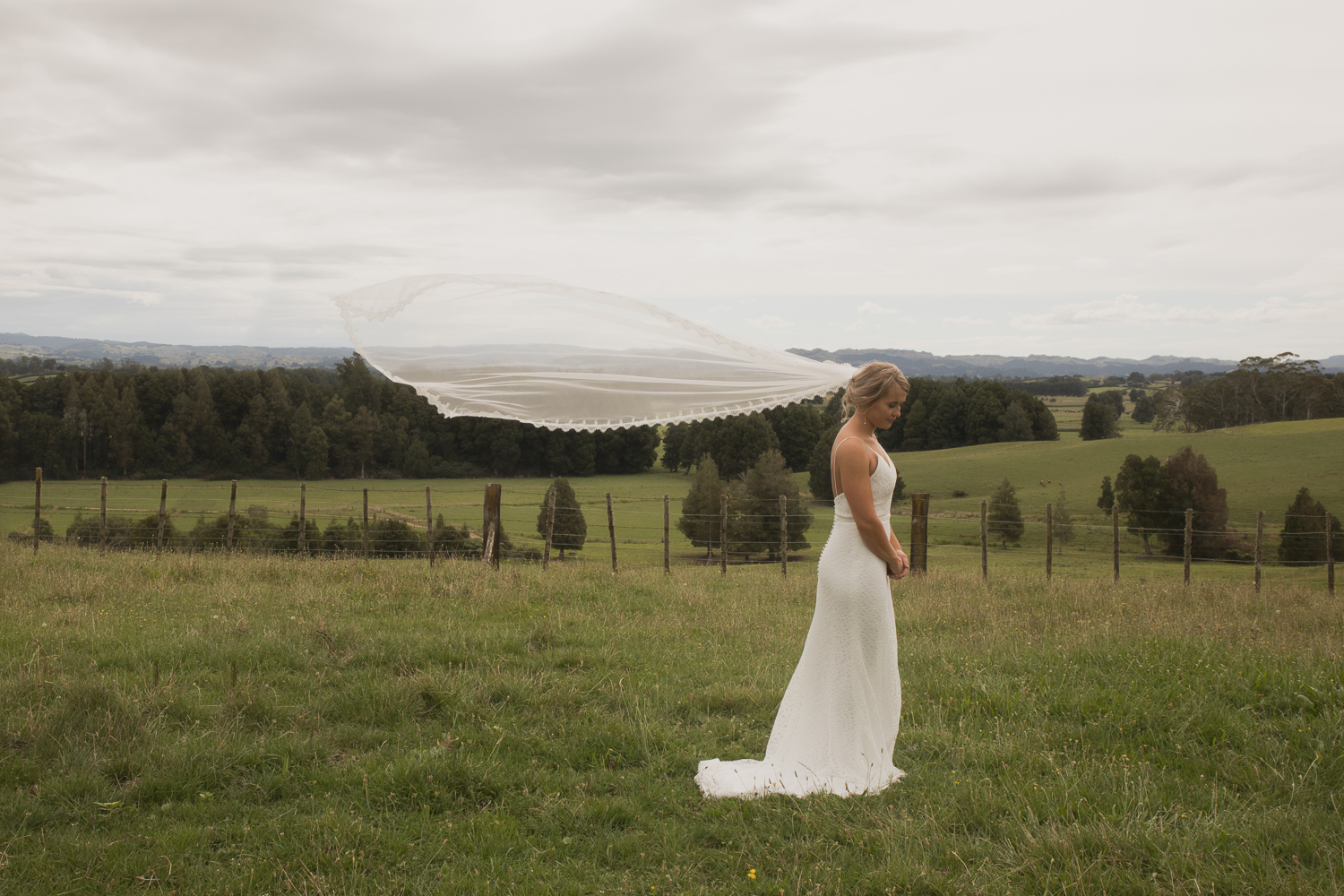 bride looking beautiful with floating veil