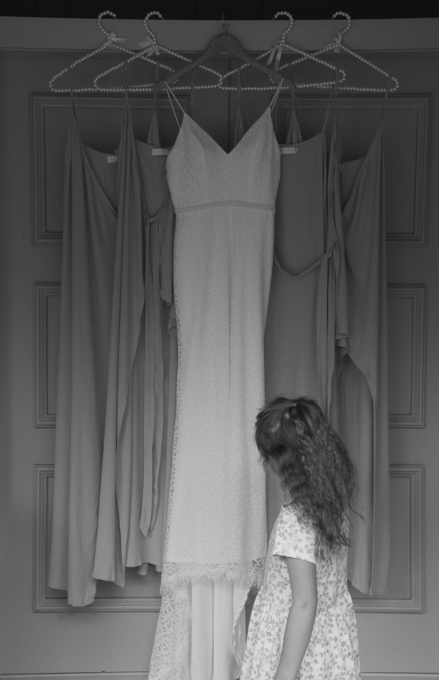 flower girl admiring wedding dress