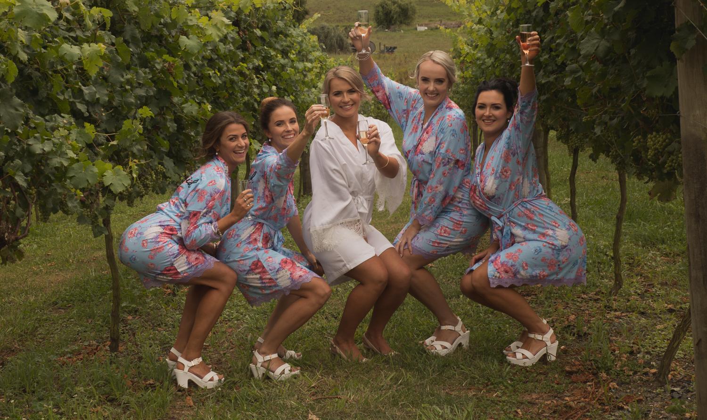bridesmaids and bride having fun