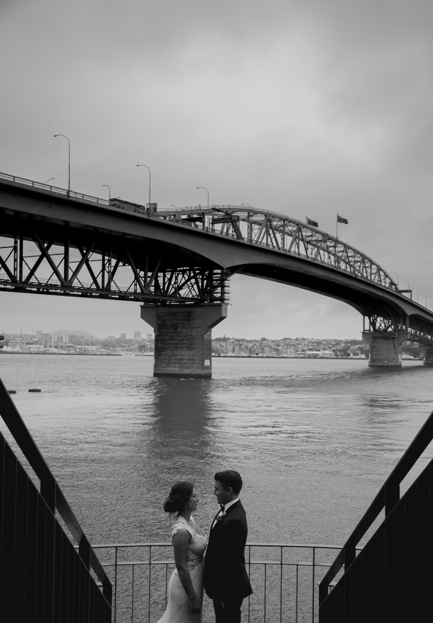 bride and groom underneath the Auckland Harbour Bridge