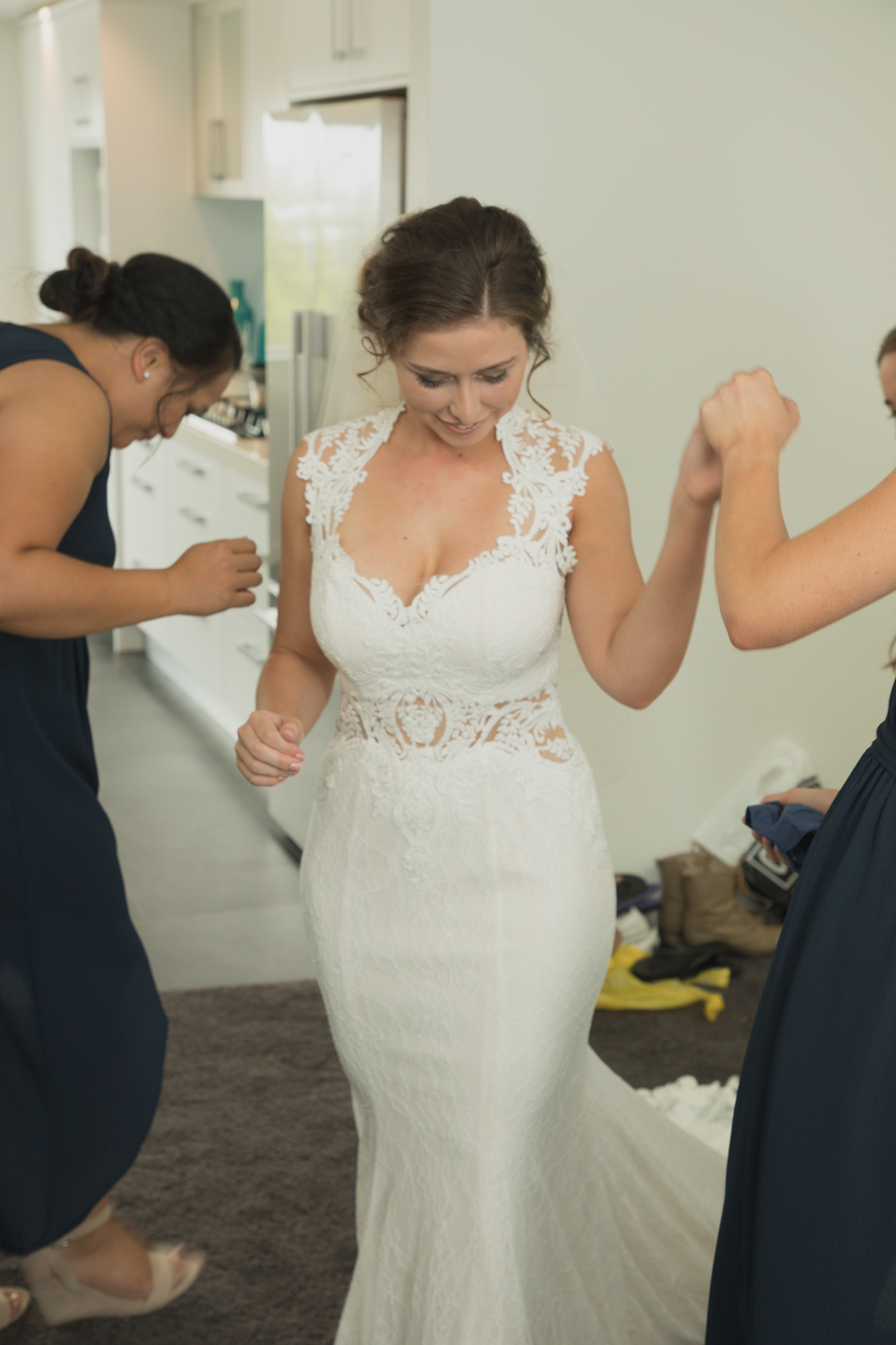 bride-showing-bridesmiads-dress-for-first-time.jpg