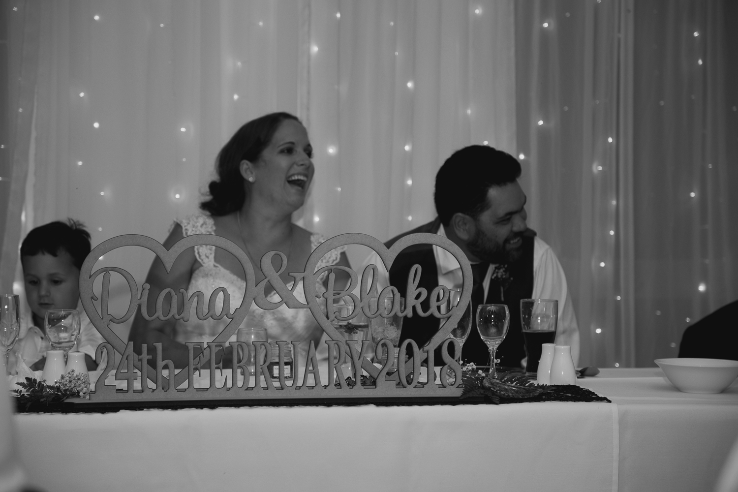 bride and groom laughing during speeches at Wedding reception