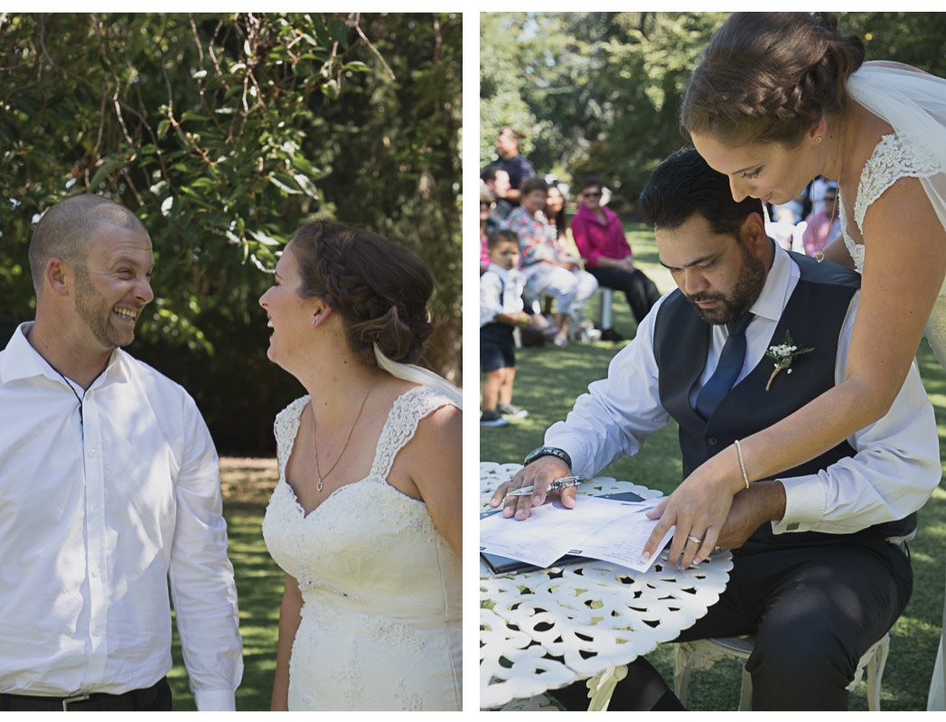 bride and groom during wedding ceremony signing register