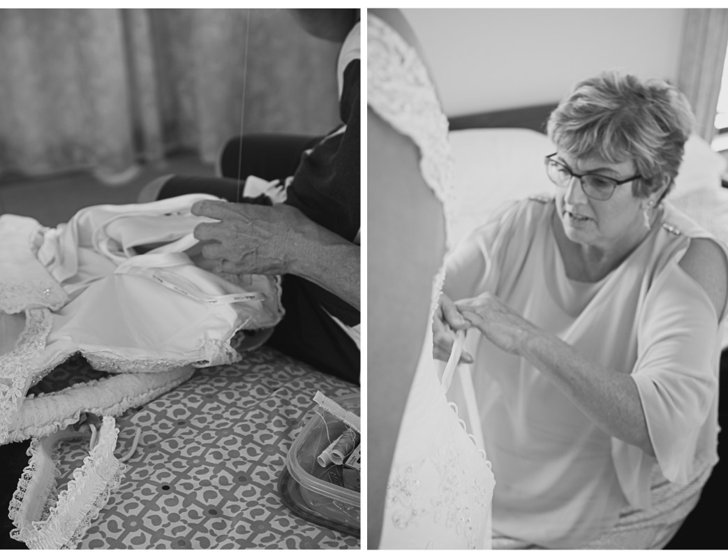 mother of the bride sewing up wedding dress