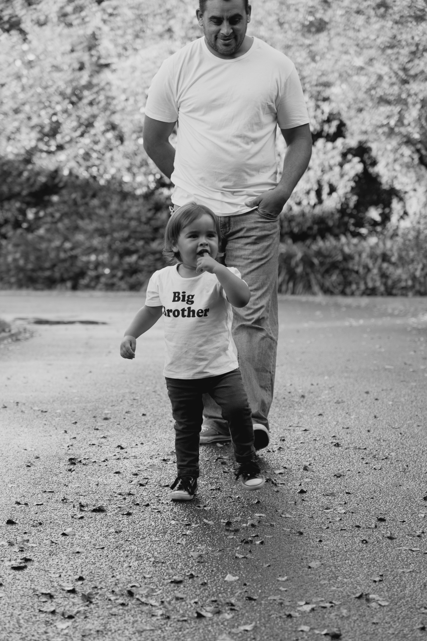 little boy running with dad