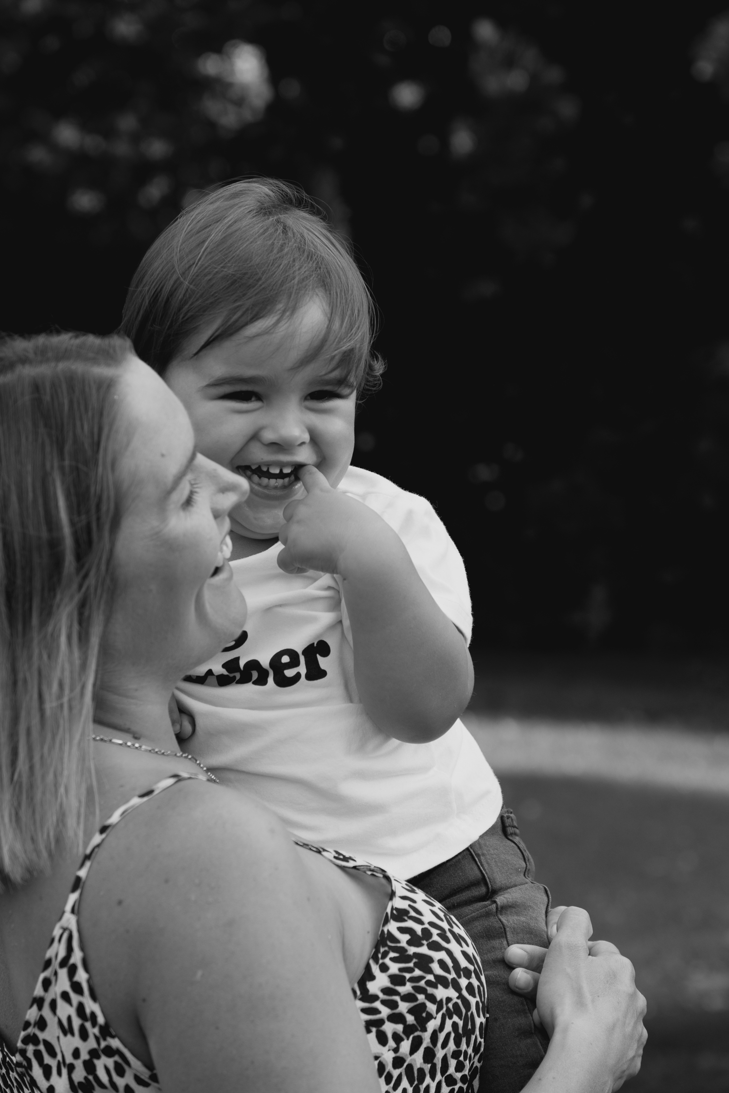 cute little boy laughing with his mum