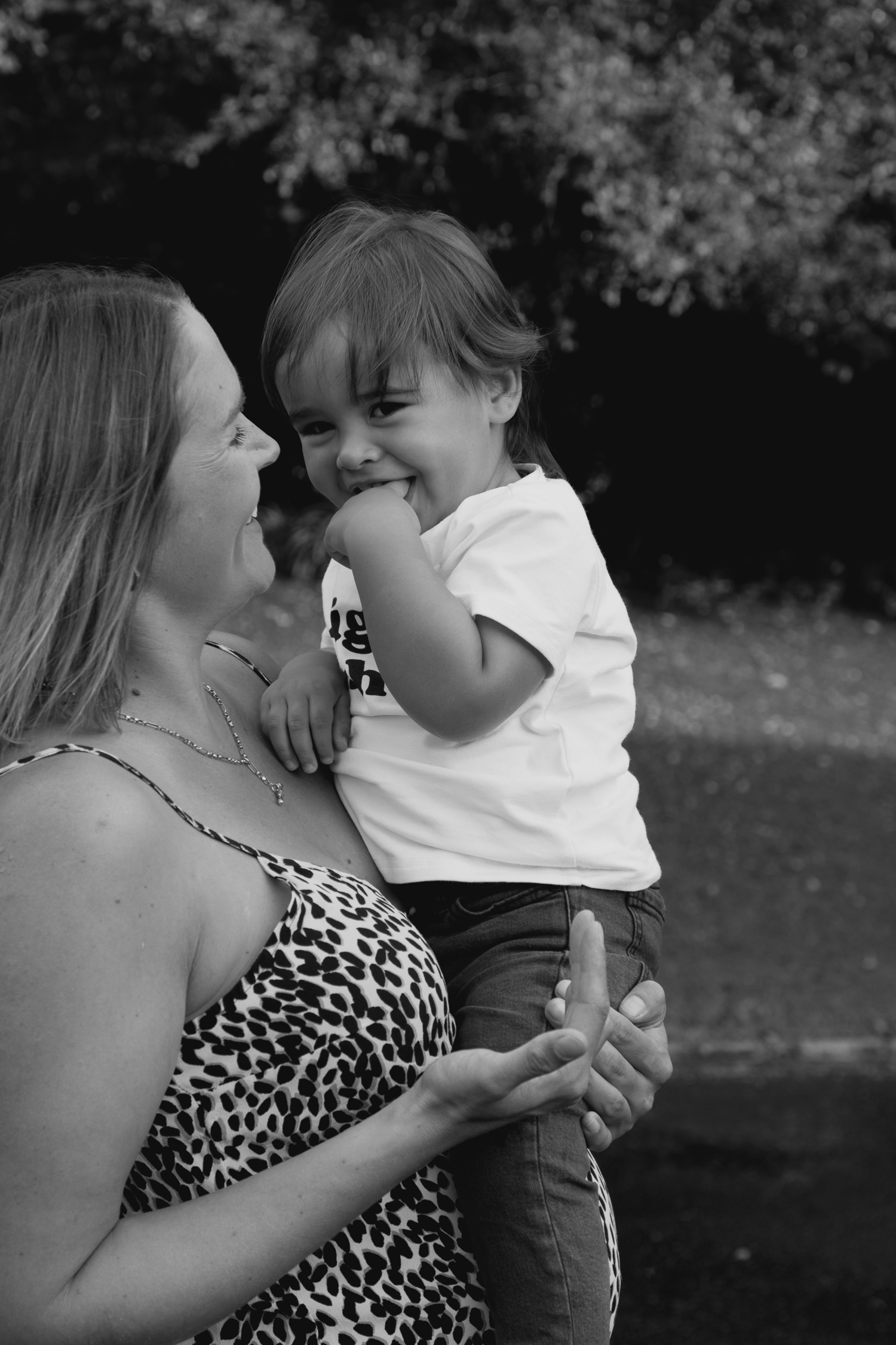 cute toddler laughing with mum