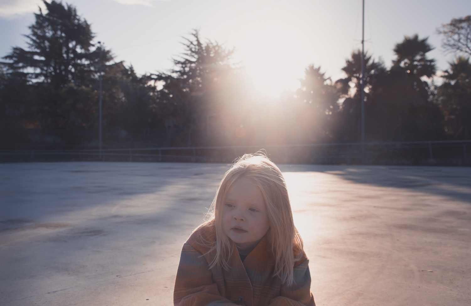 little girl at sunset playing