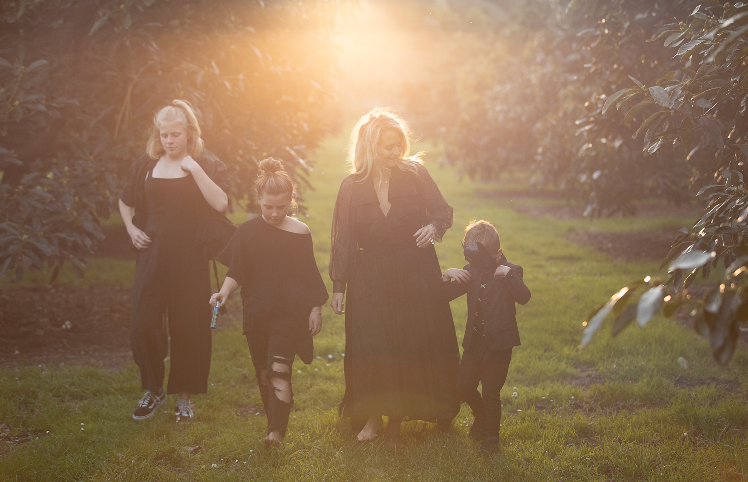 family in black at sunset