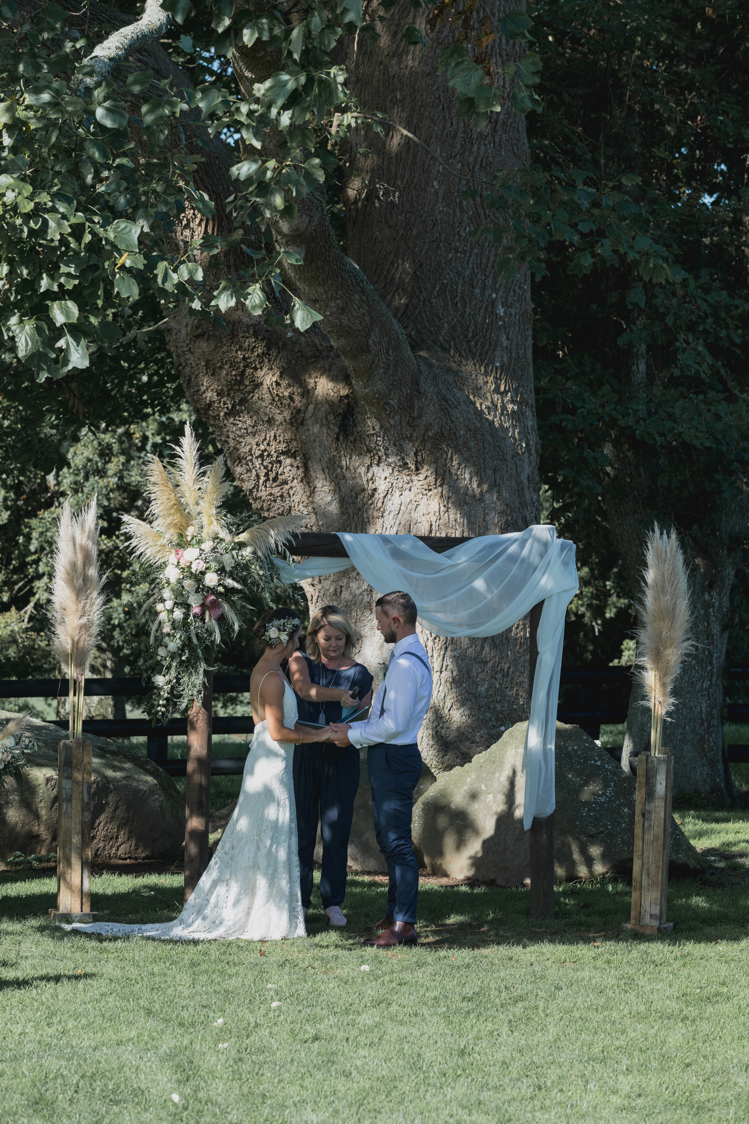 wedding-at-the-red-barn-new-zealand-wedding-photographer-bride-and-groom-standing-at-alter.jpg