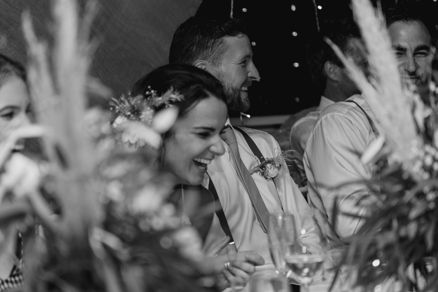 wedding-at-the-red-barn-new-zealand-wedding-photographer-groom-and-bride-laughing.jpg