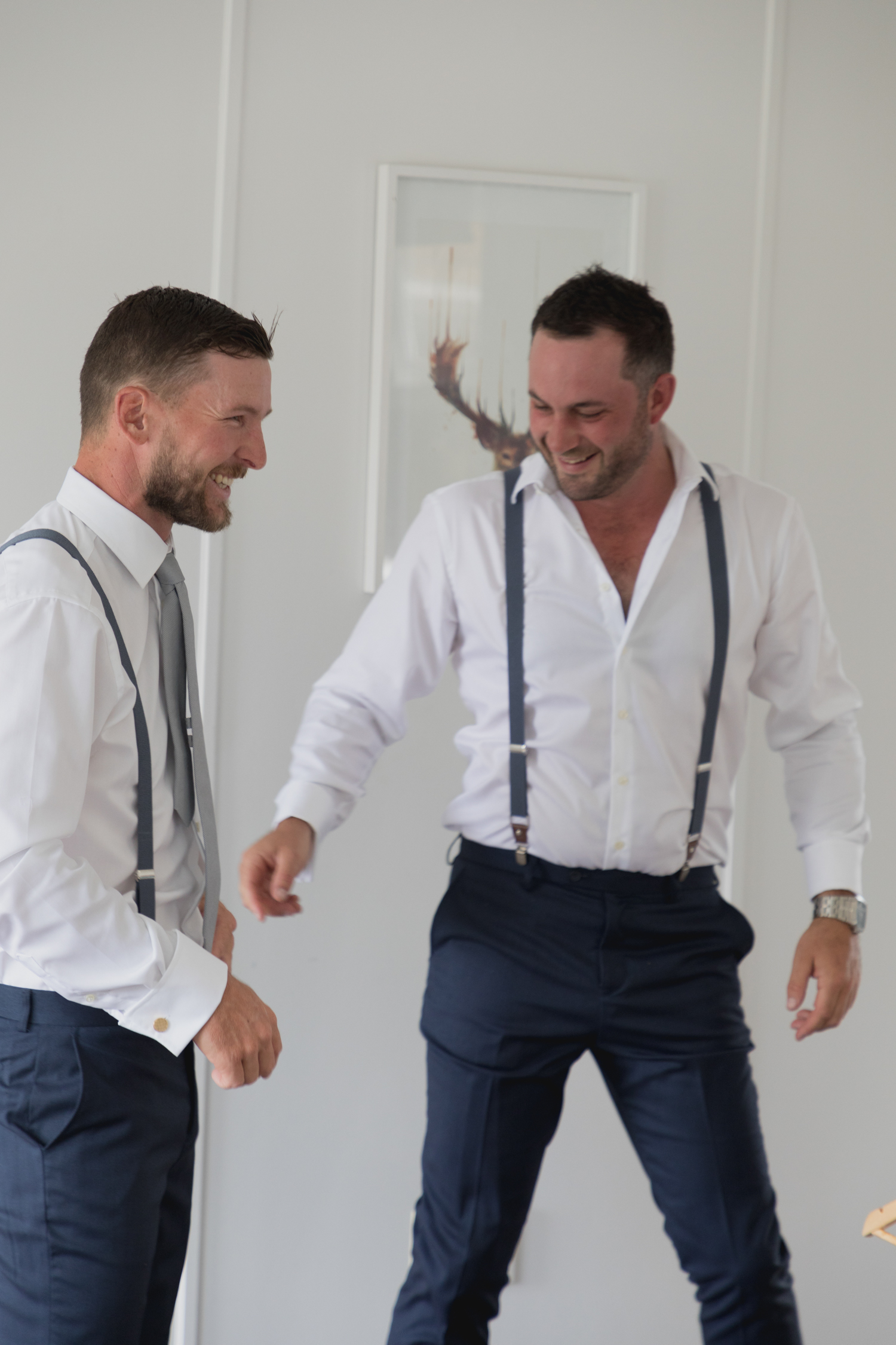 wedding-at-the-red-barn-new-zealand-wedding-photographer-groom-and-groomsmen-laughing-together.jpg