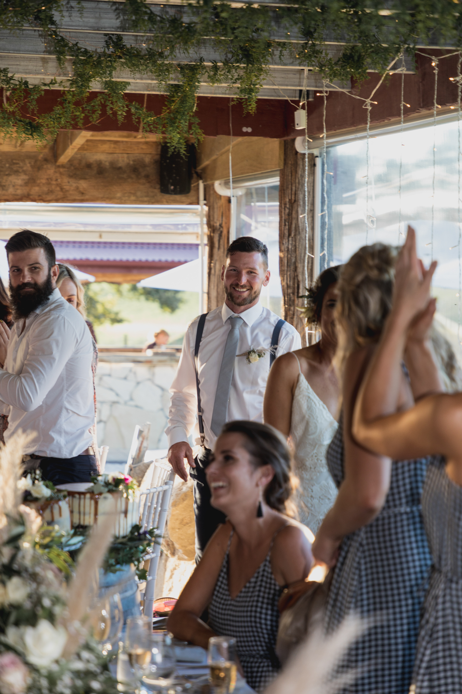 wedding-at-the-red-barn-new-zealand-wedding-photographer-groom-arriving-at-reception.jpg