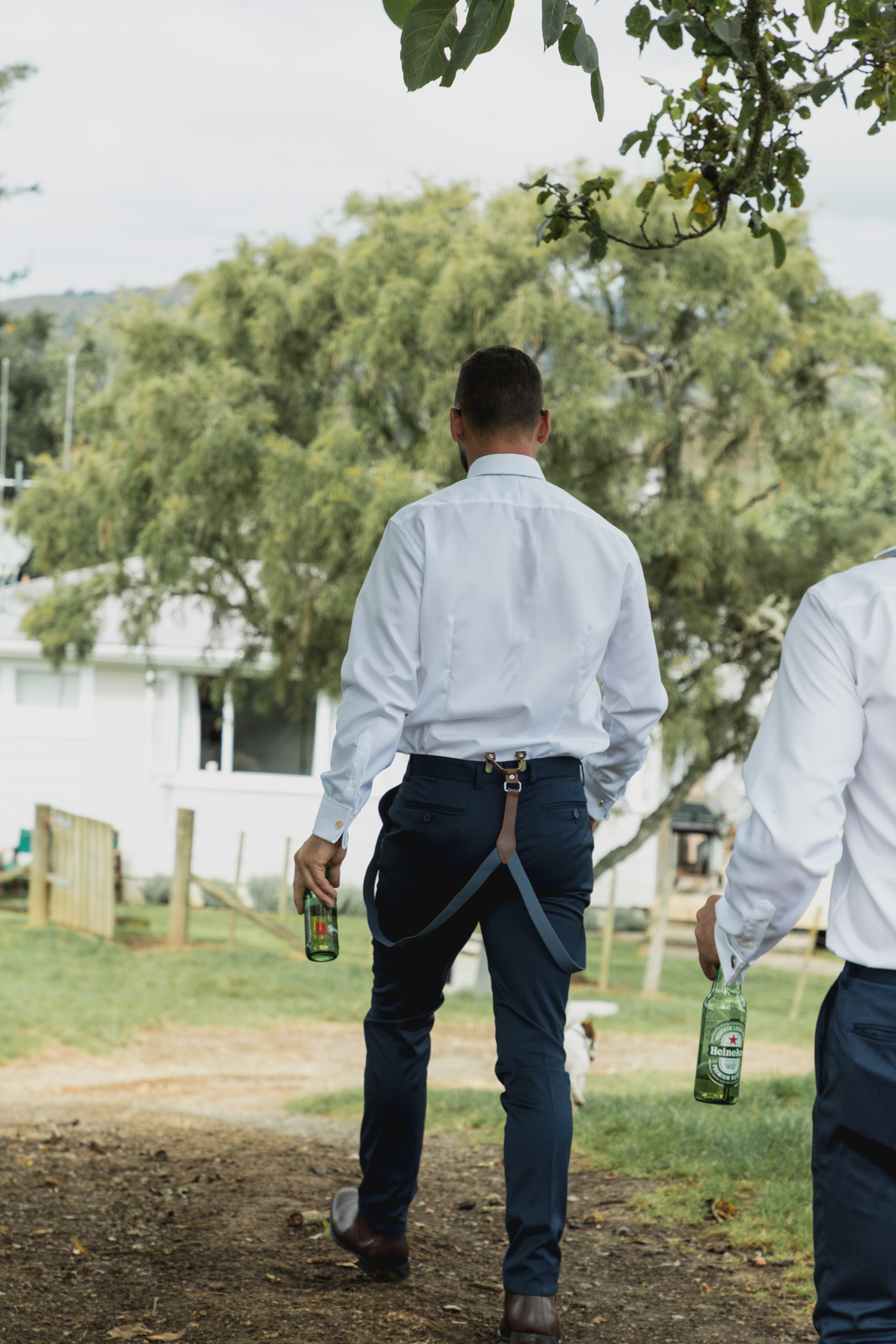 wedding-at-the-red-barn-new-zealand-wedding-photographer-groom-having-a-beer.jpg