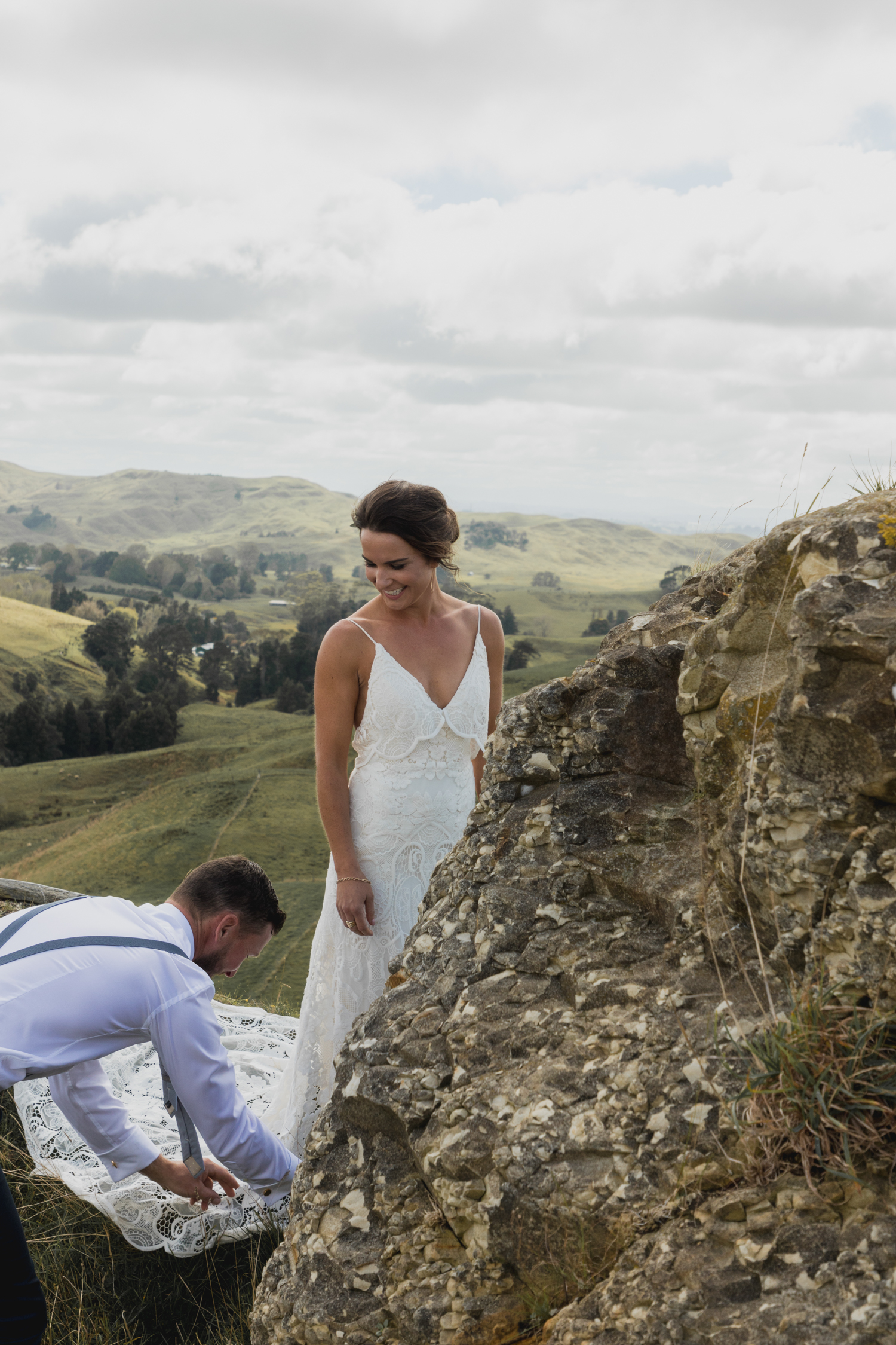 wedding-at-the-red-barn-new-zealand-wedding-photographer-groom-helping-bride-with-her-dress.jpg