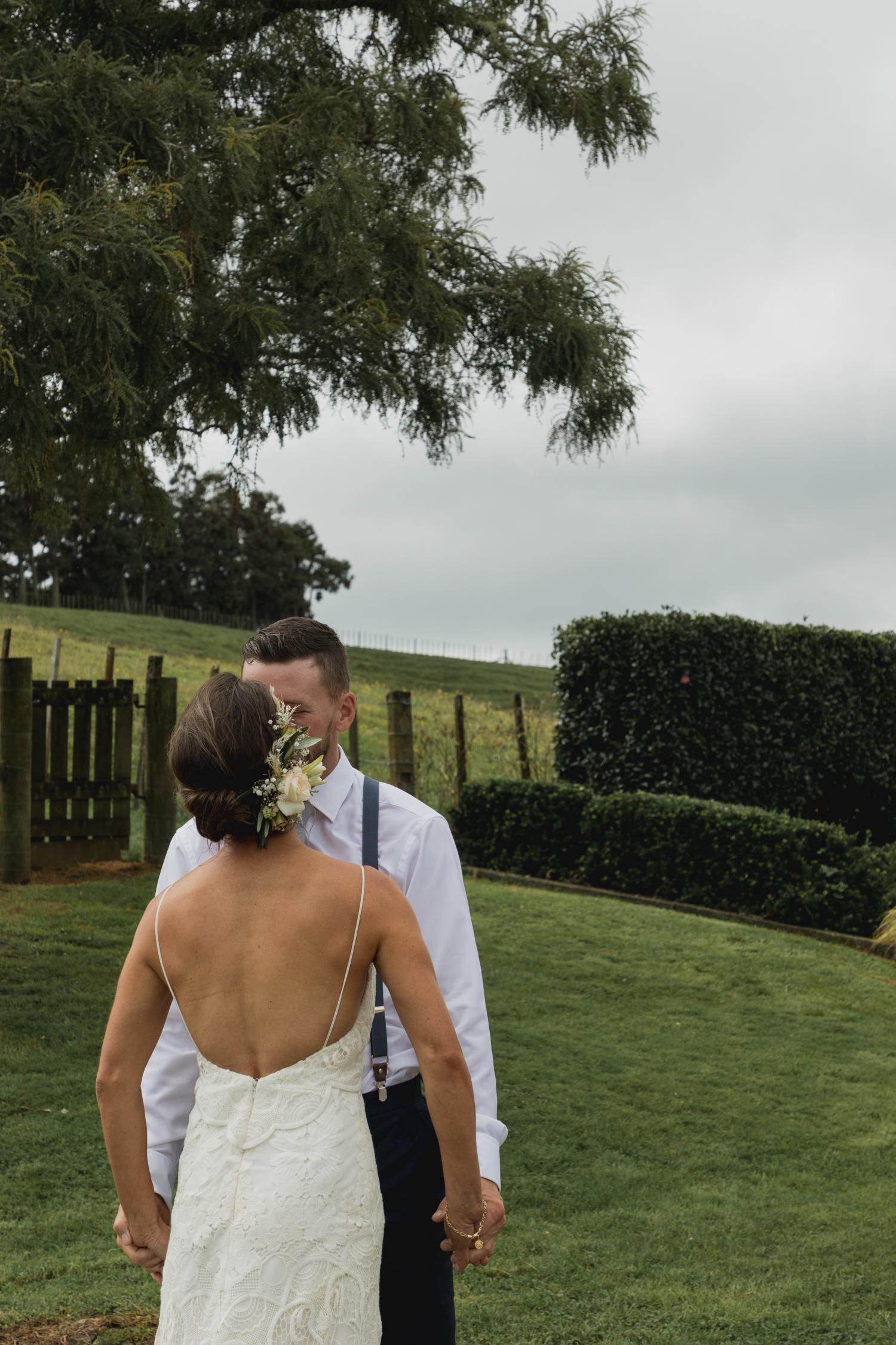 wedding-at-the-red-barn-new-zealand-wedding-photographer-groom-kissing-his-bride.jpg