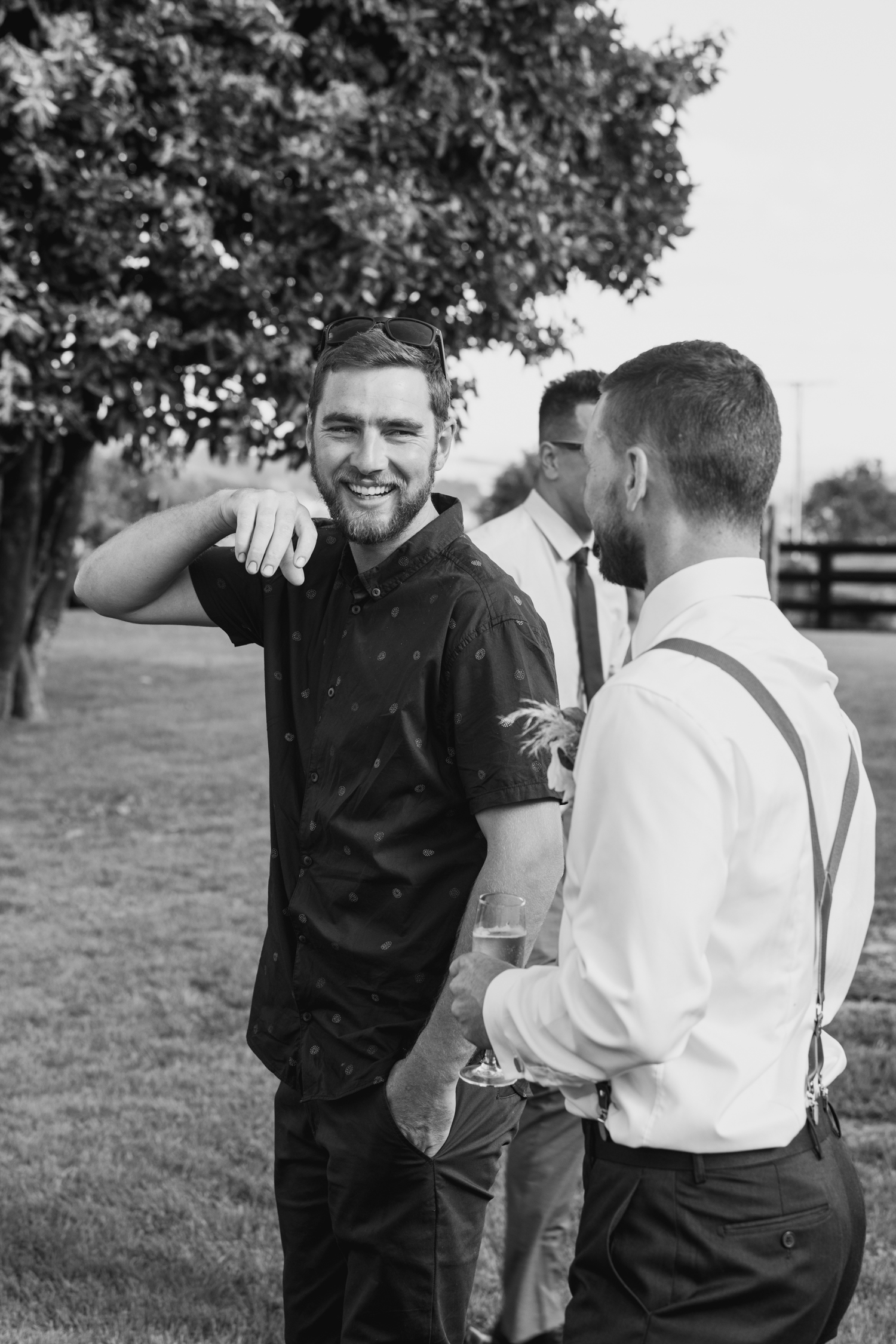 wedding-at-the-red-barn-new-zealand-wedding-photographer-groom-laughing-with-friend.jpg