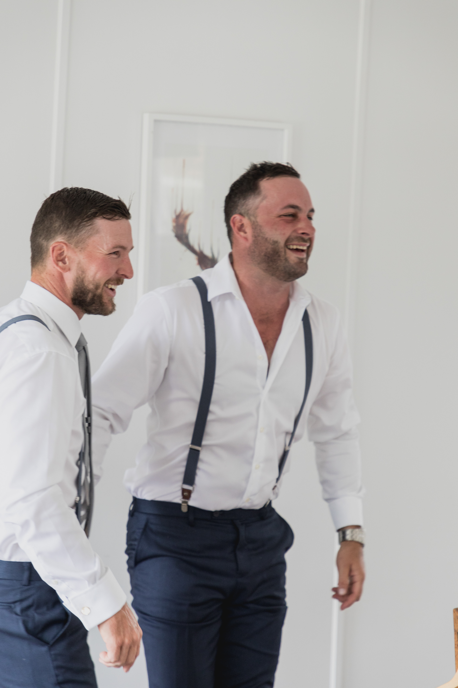 wedding-at-the-red-barn-new-zealand-wedding-photographer-groom-laughing-wtih-mates.jpg