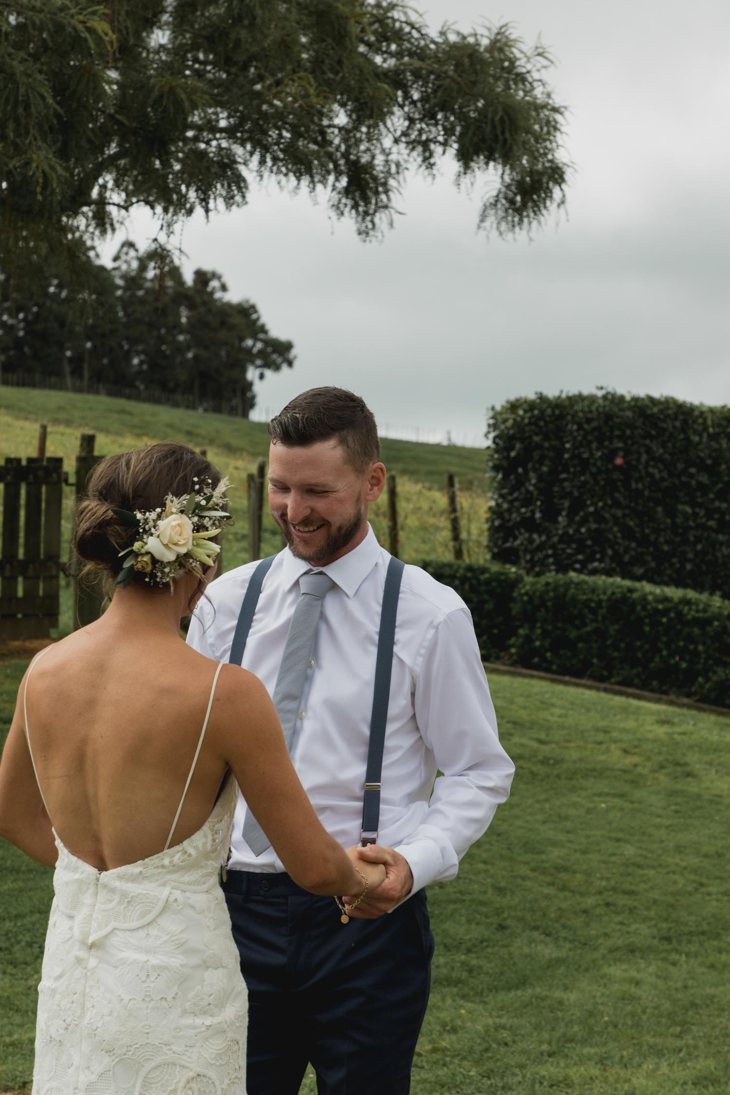 wedding-at-the-red-barn-new-zealand-wedding-photographer-groom-seeing-bride-in-her-dress.jpg