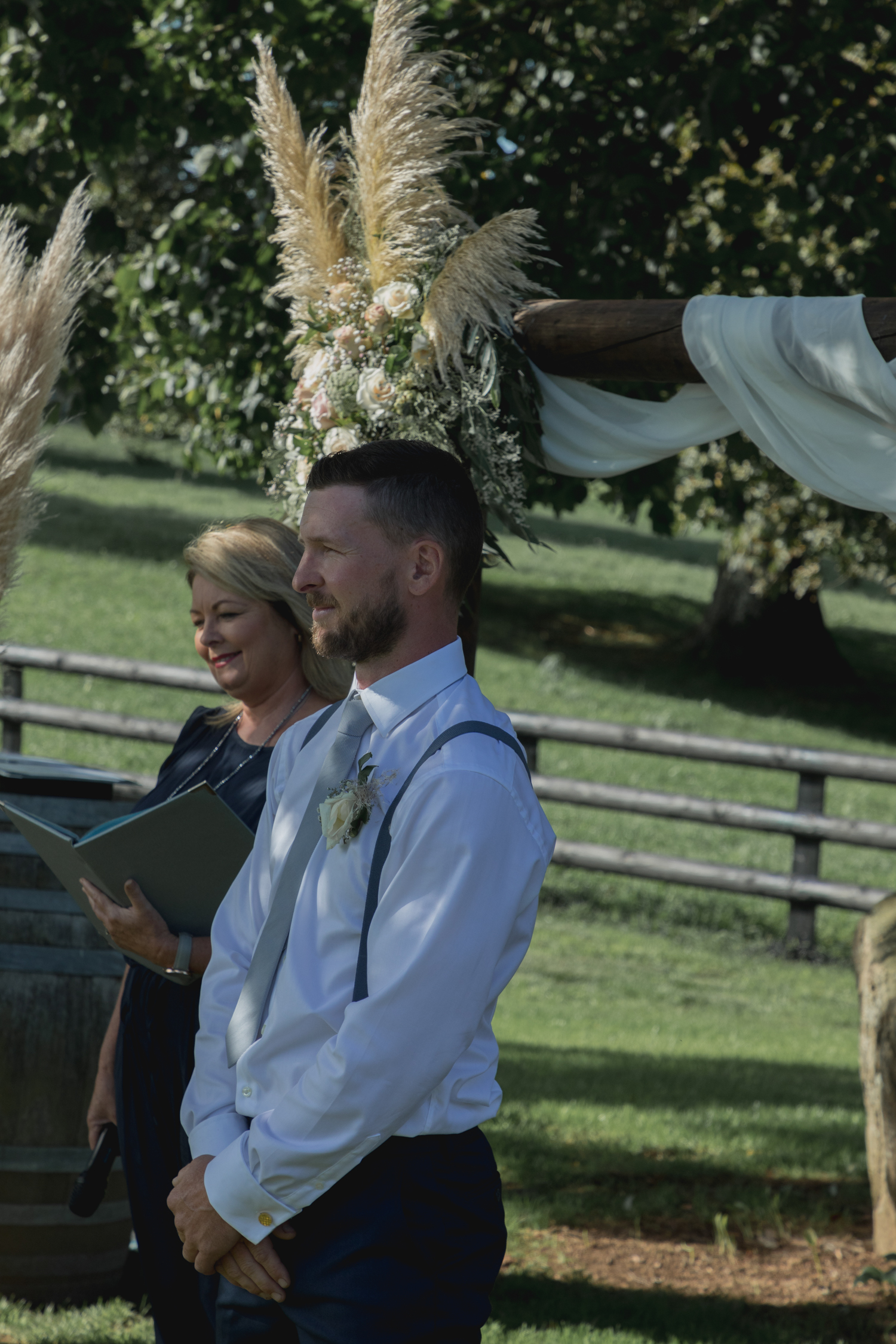 wedding-at-the-red-barn-new-zealand-wedding-photographer-groom-waiting-for-bride-at-the-alter.jpg